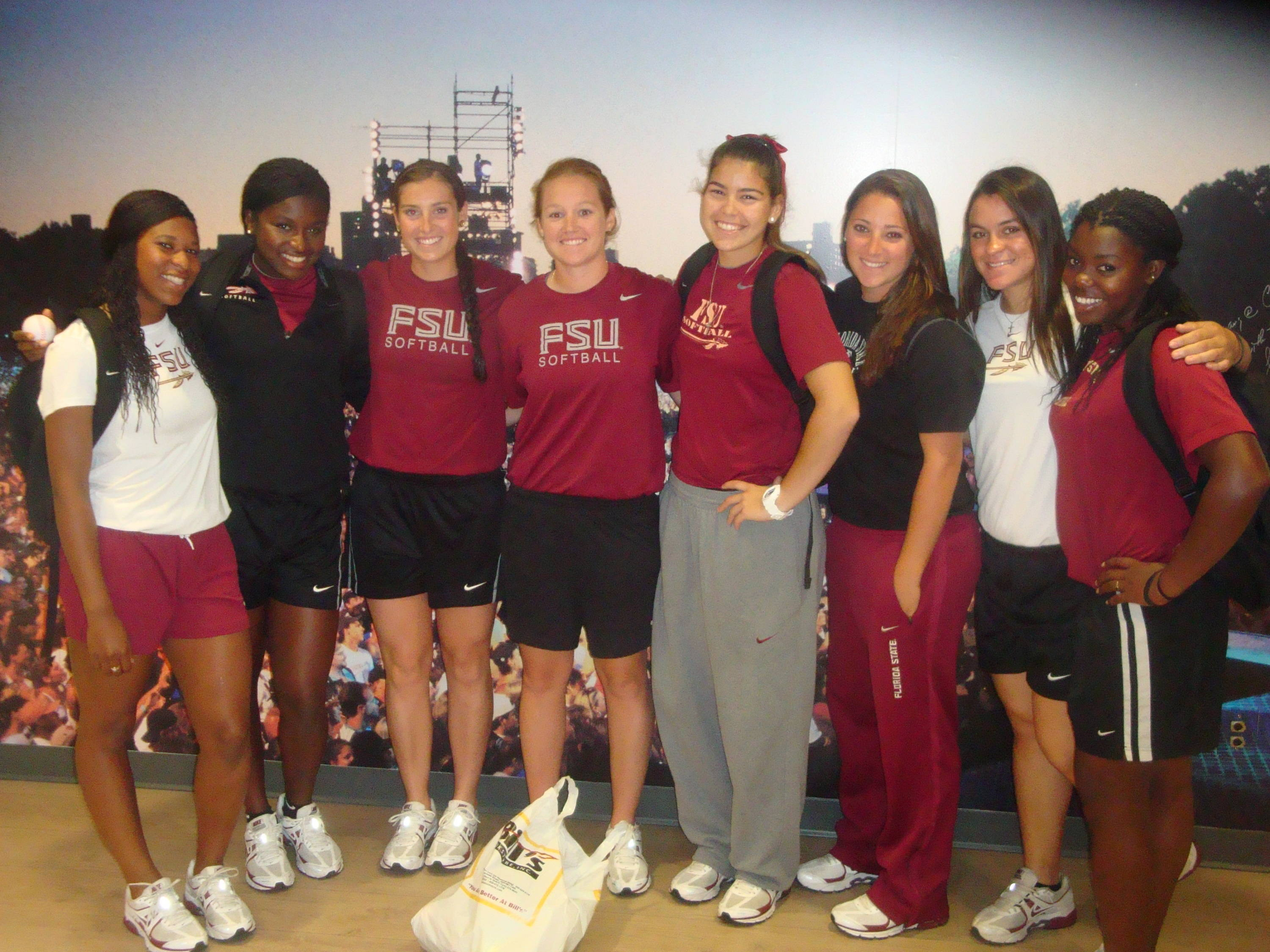 The FSU softball squad poses in one of the nicely designed rooms. They are eagerly waiting to have fun with the kids at the children's center!