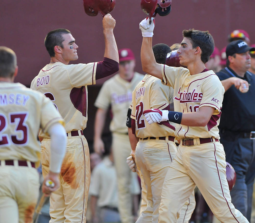 ...that is, unless it's Justin Gonzalez (right) celebrating his three-run homer in the sixth inning, which broke the game wide open. The 'Noles will go after their 21st College World Series appearance Monday at 7 p.m.