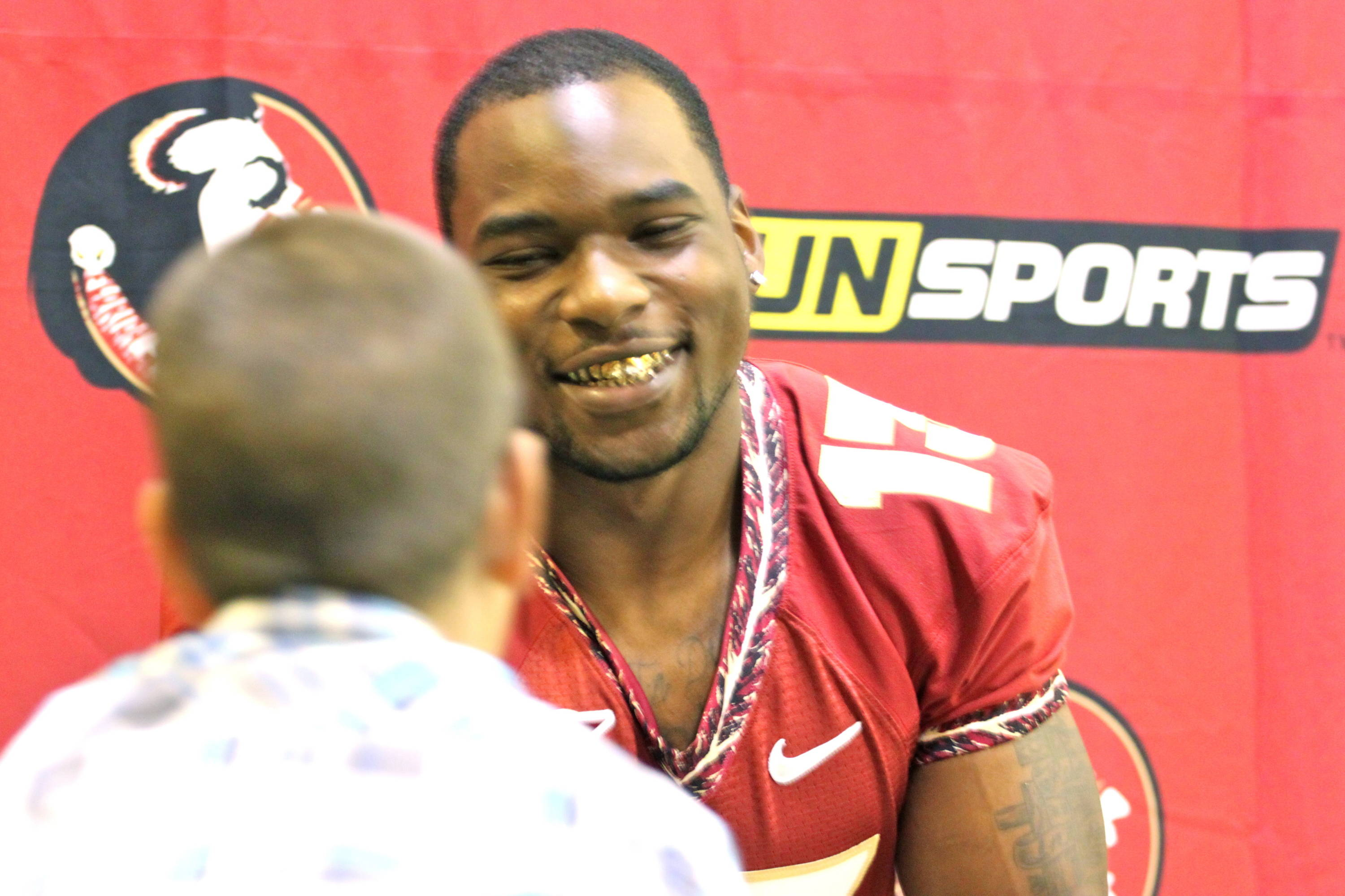 Nigel Bradham and Jr. Nole reporter Blaine Thomas at football media day.