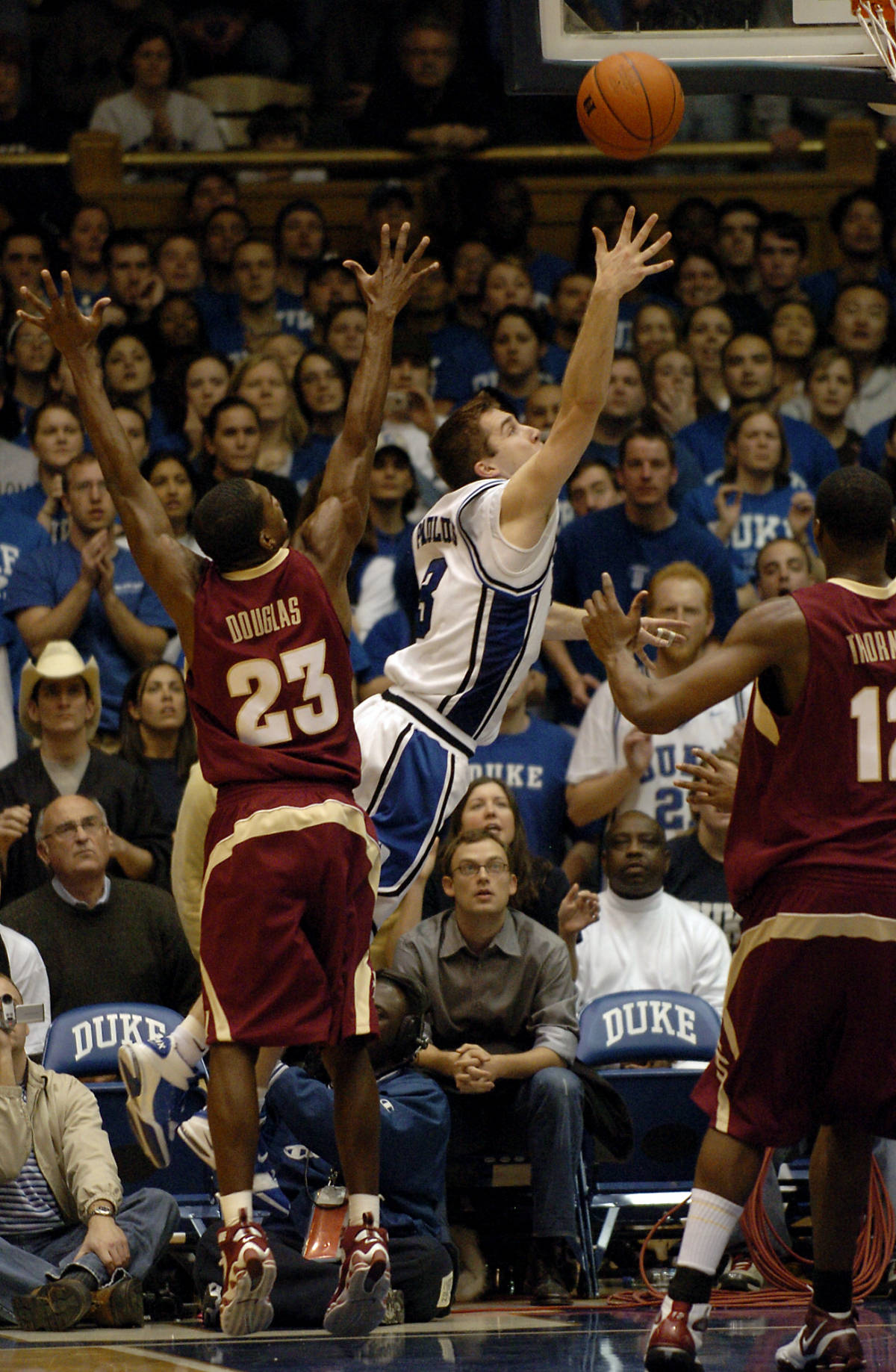 Duke's Greg Paulus, center, misses the lay-up over Florida State's Toney Douglas (23) in the last six seconds of a basketball game in Durham, N.C., on Sunday, Feb. 4, 2007. Paulus' missed lay-up led the sequence of three missed attempts before losing, 68-67, to Florida State in the final seconds. Paulus led his team with 23 points. (AP Photo/Sara D. Davis)