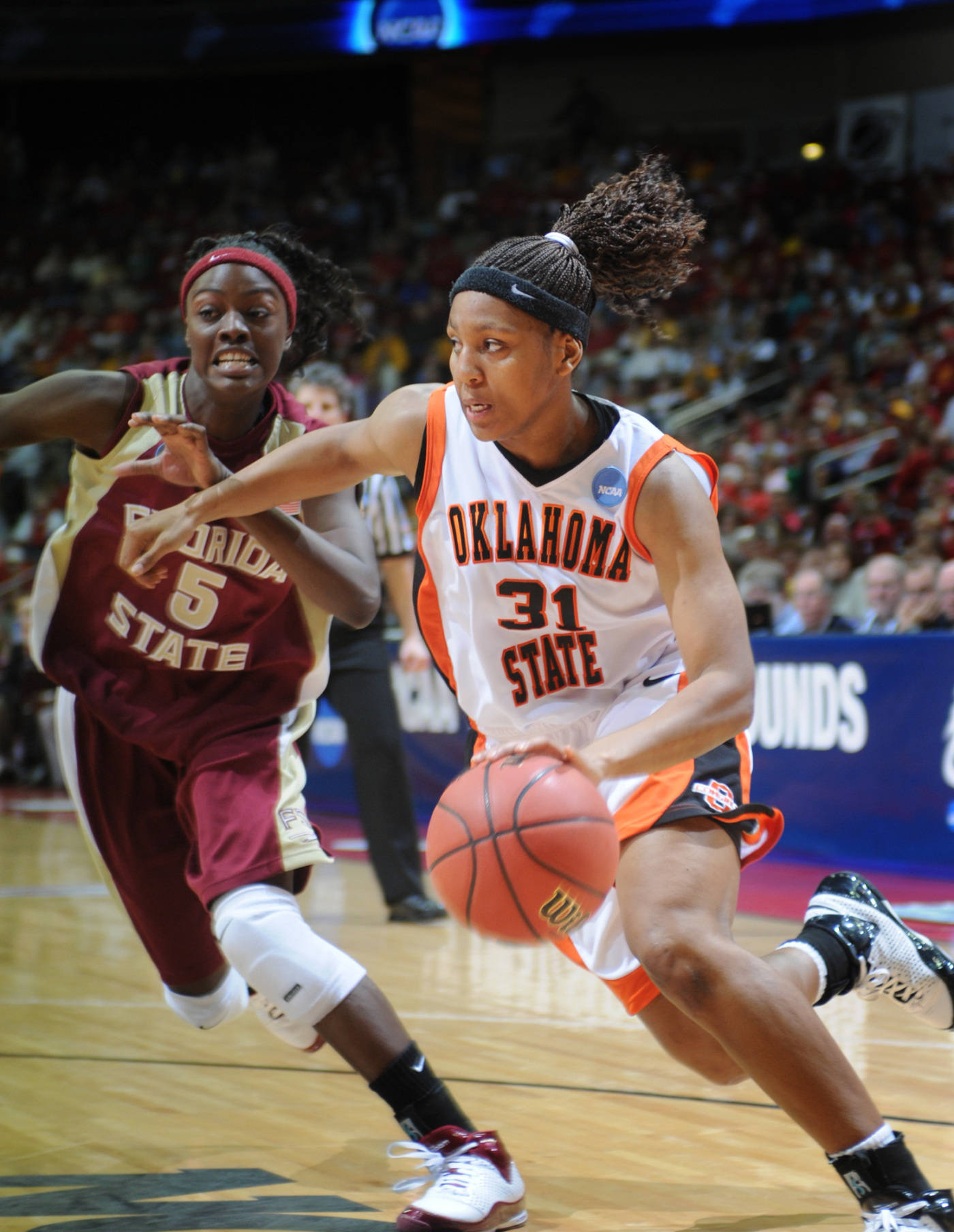 Oklahoma State's Danielle Green (31) drives to the basket against Florida State's Christian Hunnicutt during the second half of a second round NCAA women's basketball tournament game, Monday March 24, 2008 in Des Moines, Iowa. Green led all scorers with 23 points as Oklahoma State won 73-72. (AP Photo/Steve Pope)