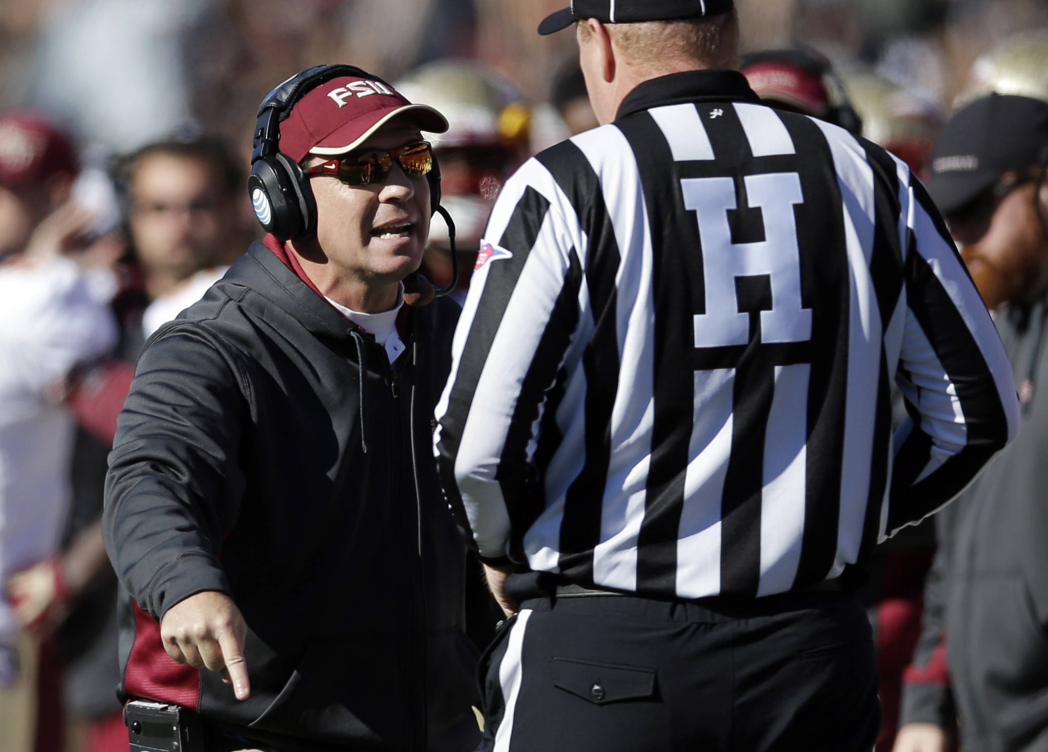 Head coach Jimbo Fisher speaks with head linesman Michael Kelley in the first half of an NCAA college football game against Maryland in College Park, Md., Saturday, Nov. 17, 2012. (AP Photo/Patrick Semansky)