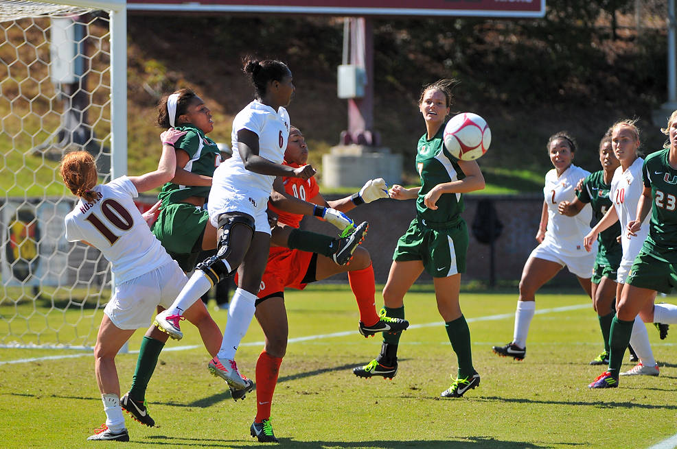 Tori Huster and Jessica Price in the mix looking for a goal.