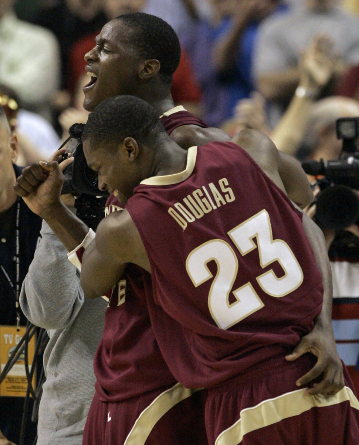 Florida State's Toney Douglas (23) hugs Al Thornton after beating Clemson 67-66 in a first round game of the Men's Atlantic Coast Conference basketball tournament in Tampa, Fla., Thursday, March 8, 2007. Thornton scored 25 points, including the game-winning free throw. (AP Photo/John Raoux)