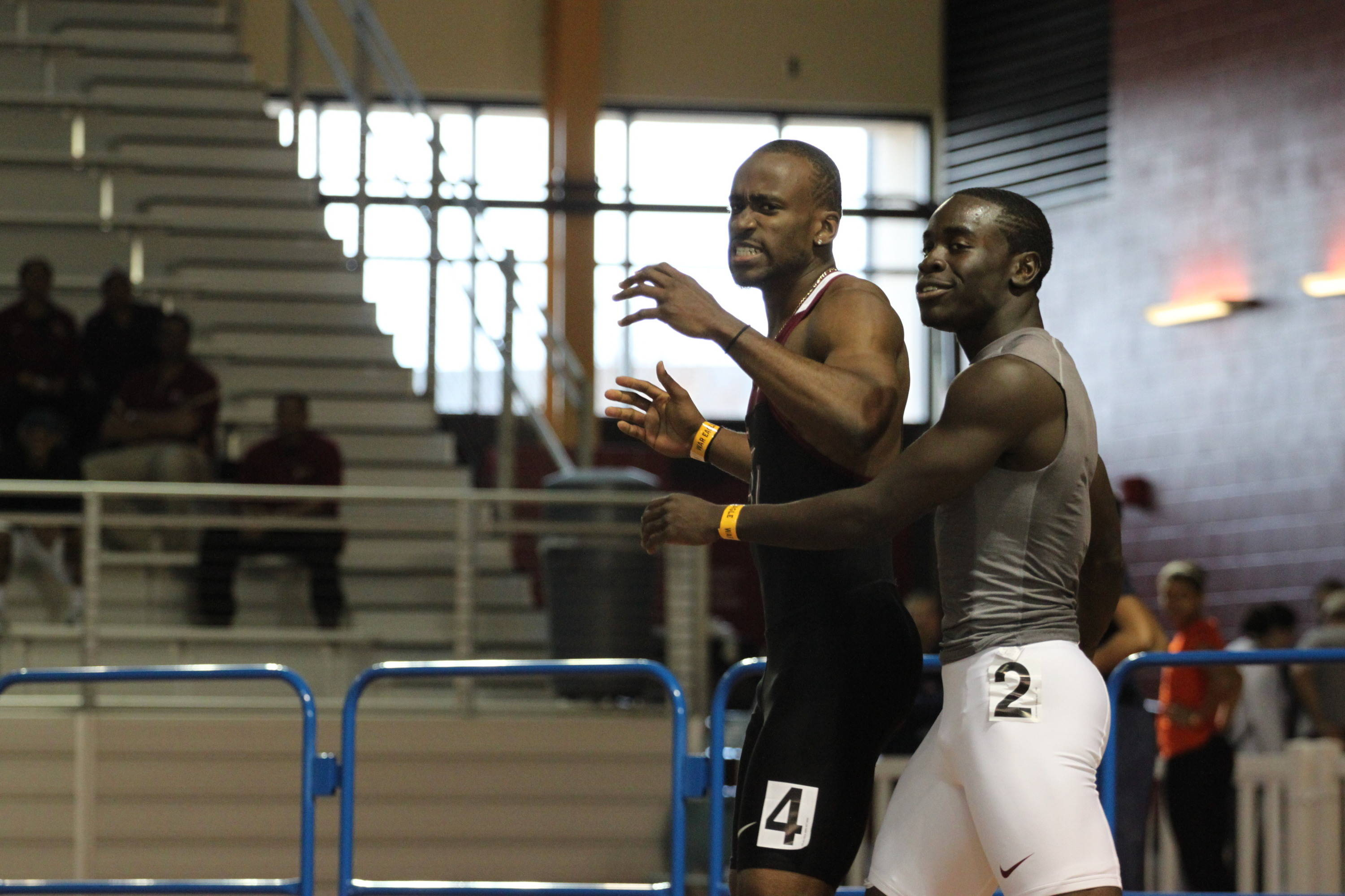 Kemar Hyman and Dentarius Locke, an FSU student who ran unattached and finished fourth, celebrate after the 60m final.