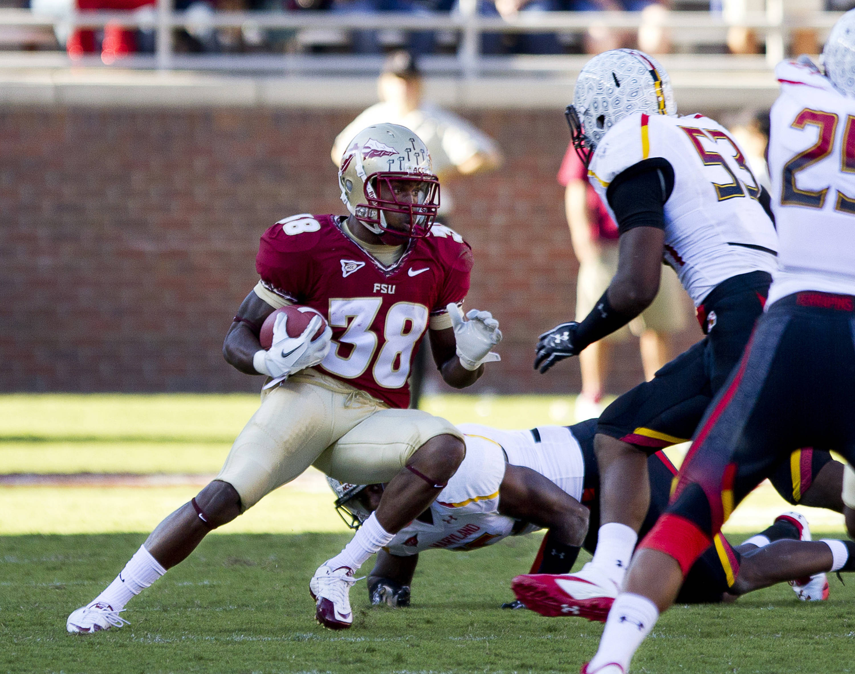 Jermaine Thomas (38) carries the ball past Maryland defenders during the football game against Maryland in Tallahassee, Florida on October 22, 2011.