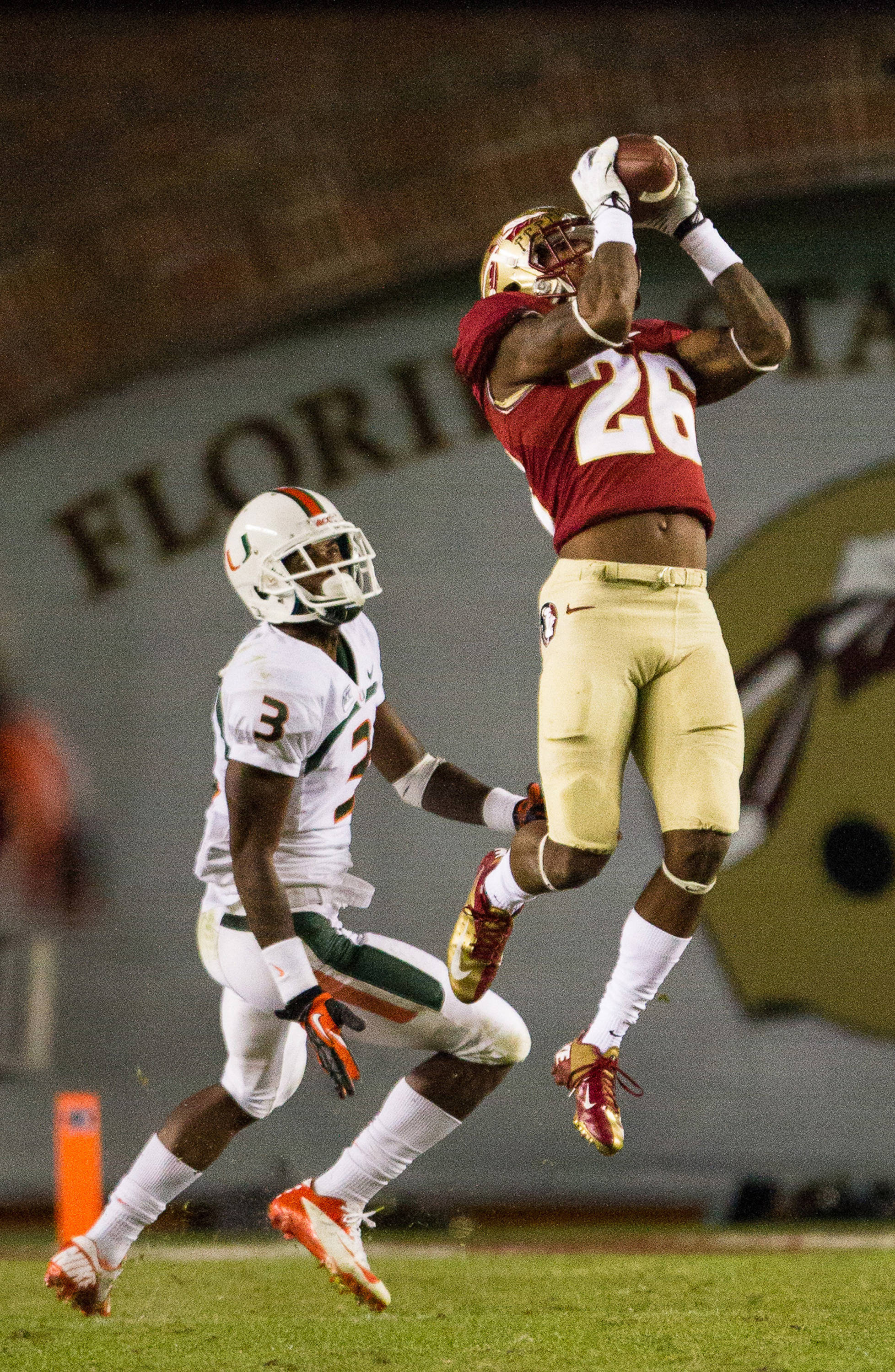 P.J. Williams (26) makes an interception during FSU football's 41-14 win over Miami on Saturday, November 2, 2013 in Tallahassee, Fla. Photo by Michael Schwarz.