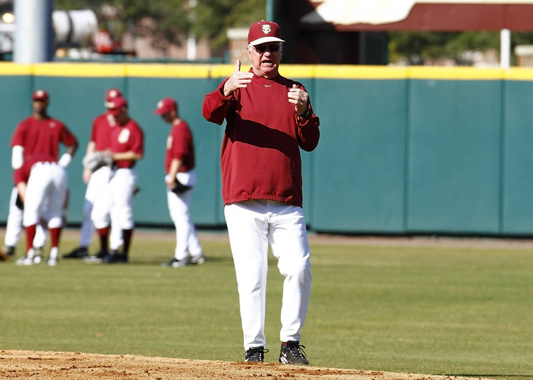 Coach Martin exhorts his team during infield drills.