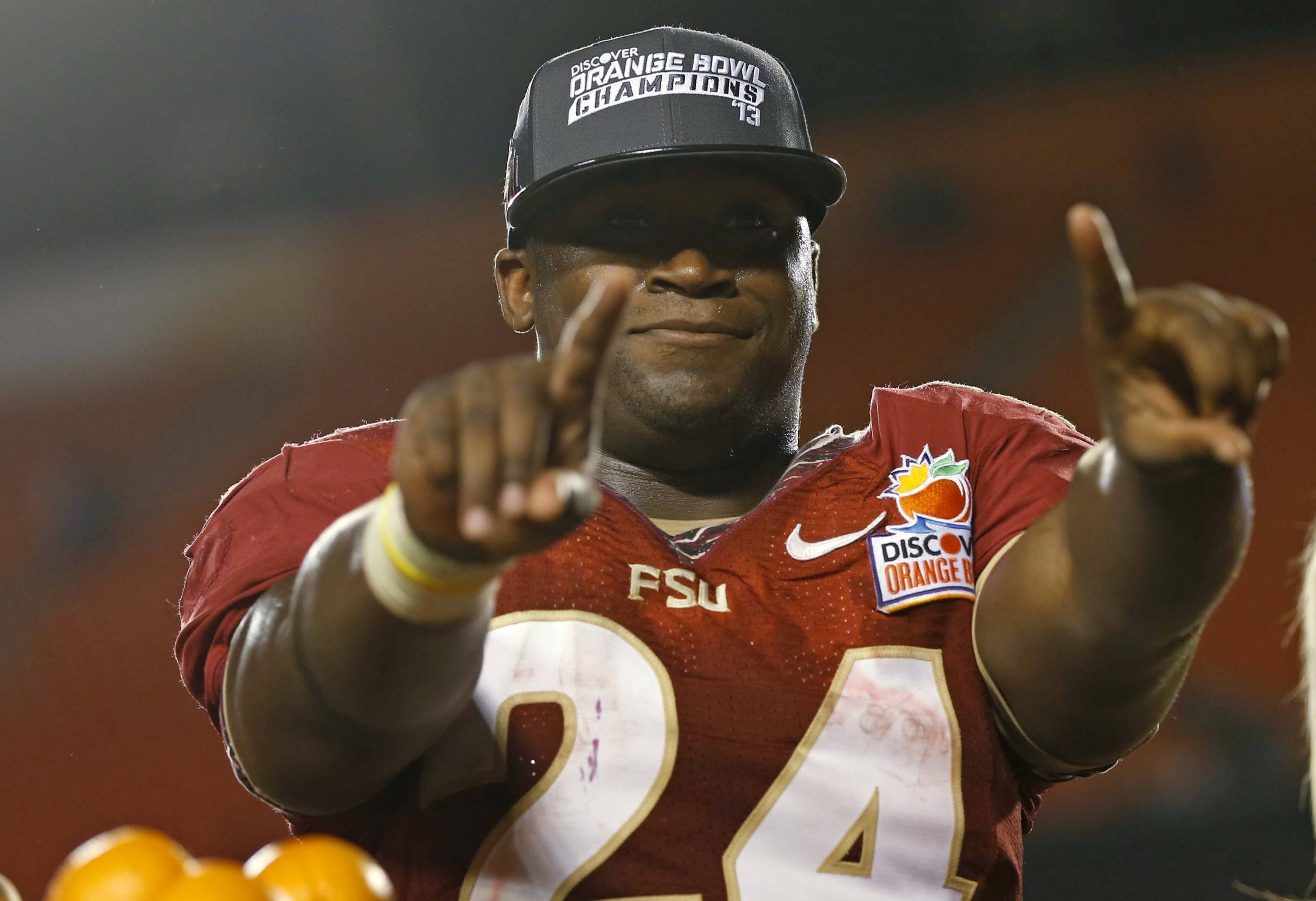 Florida State Seminoles fullback Lonnie Pryor (24), voted the game's outstanding player during the Orange Bowl NCAA college football game against Northern Illinois, early Wednesday, Jan. 2, 2013, in Miami. Pryor ran a career-high 134 yards and two touchdowns. Florida State defeated  Northern  illinois 31-10.(AP Photo/J Pat Carter)