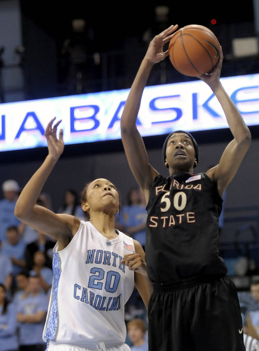 Florida State's Jacinta Monroe (50) shoots over North Carolina's Chay Shegog (20) during the second half an NCAA college basketball game in Durham, N.C., Monday, Feb. 1, 2010. Monroe led her team with 16 points for a 83-73 win over North Carolina. (AP Photo/Sara D. Davis)