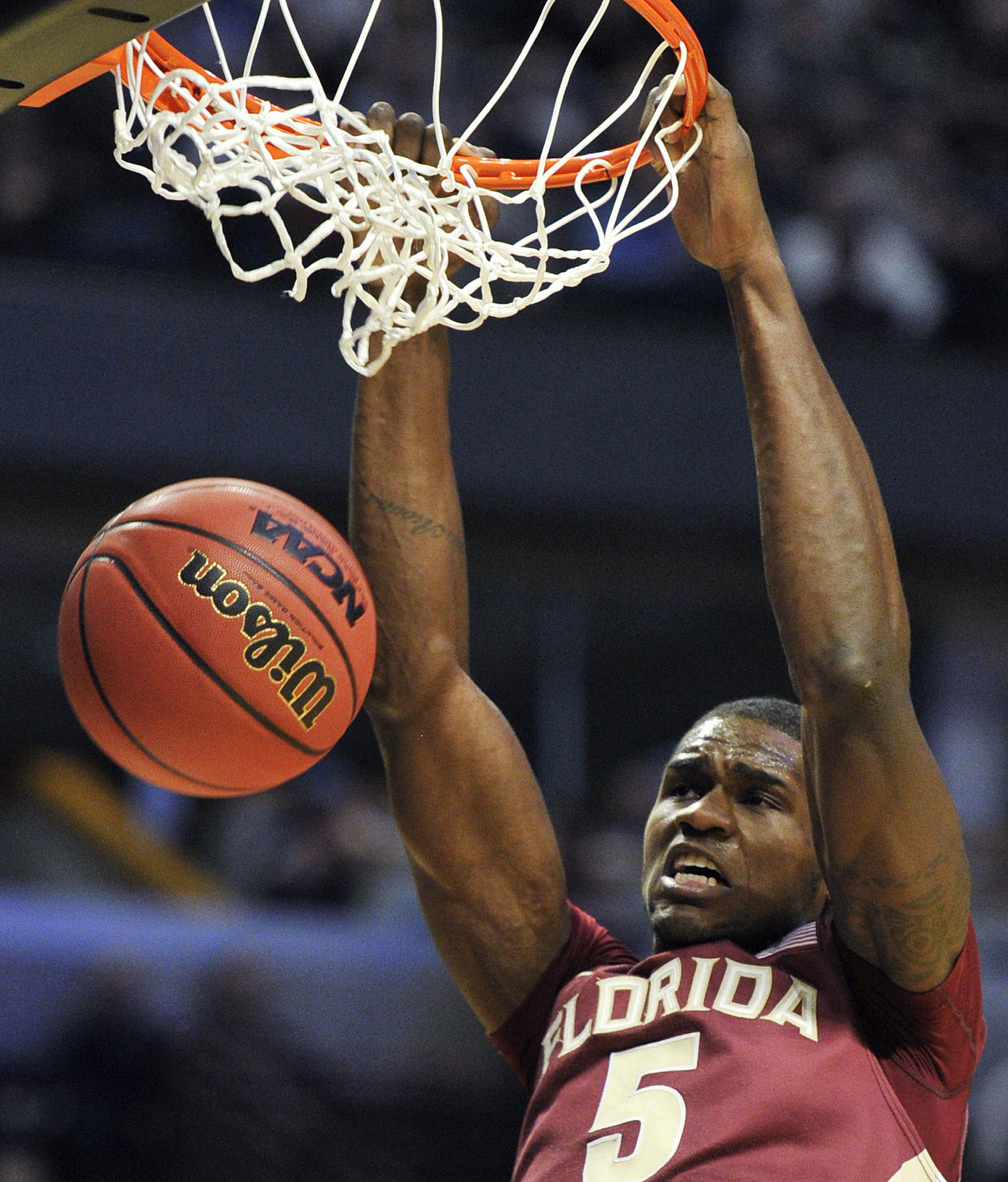 Florida State's Bernard James slam dunks against Texas A&M in the second half. (AP Photo/Jim Prisching)