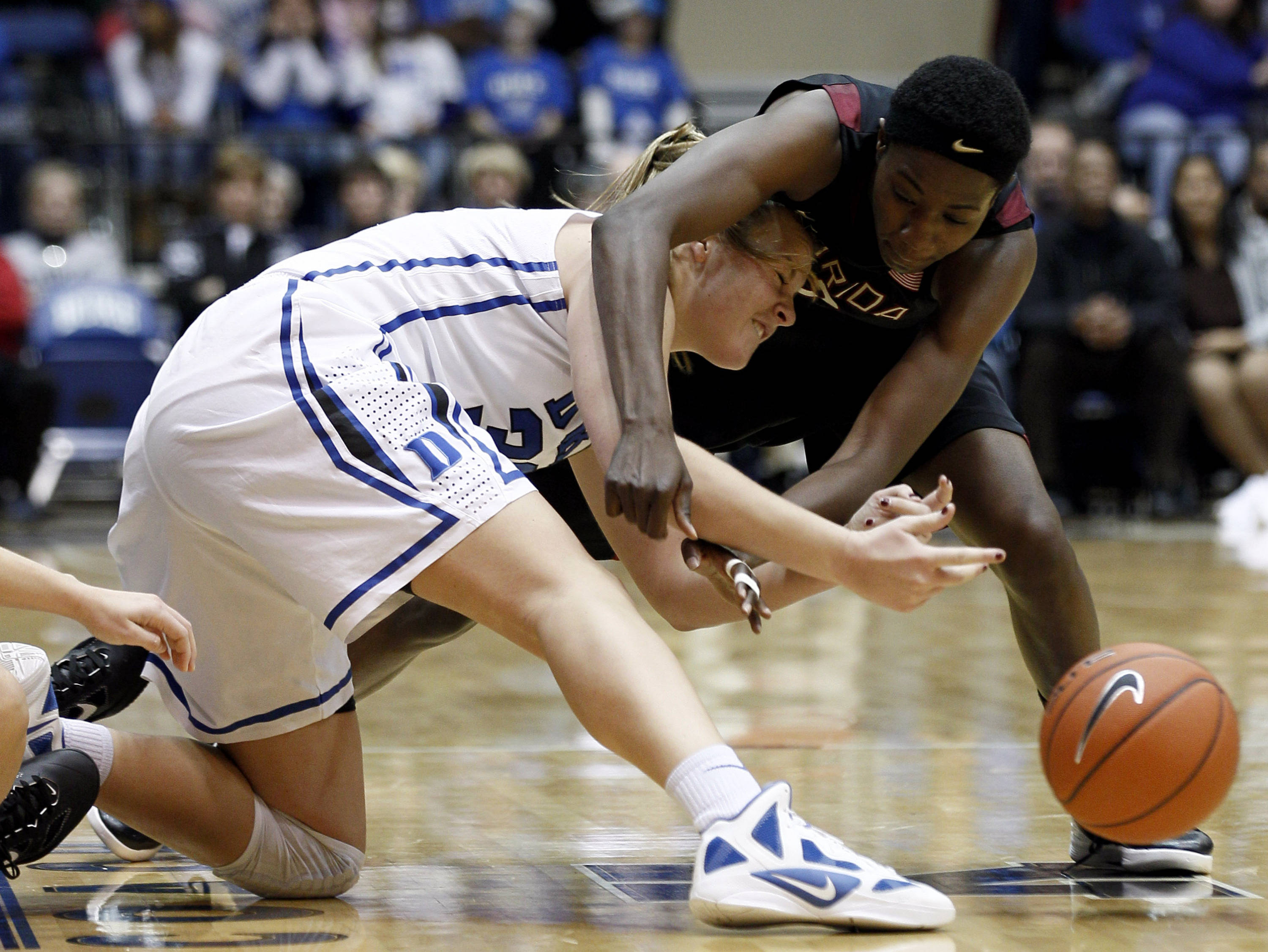 Duke's Tricia Liston and Florida State's Natasha Howard, right, chase a loose ball during the second half. (AP Photo/Gerry Broome)