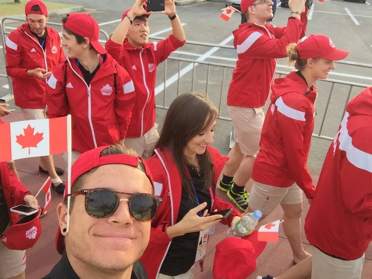 Dylan Grisell captures a selfie as Team Canada is called to march.