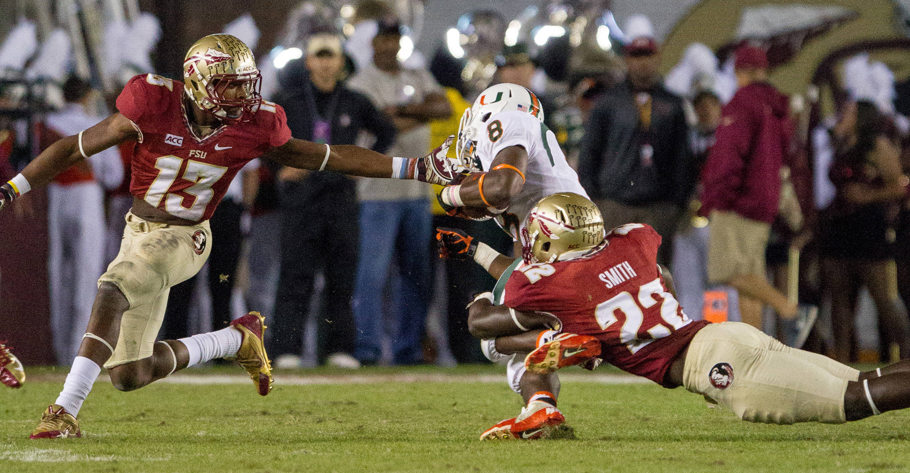 Telvin Smith (22) and Jalen Ramsey (13) take down a  ball carrier during FSU football's 41-14 win over Miami on Saturday, November 2, 2013 in Tallahassee, Fla. Photo by Michael Schwarz.