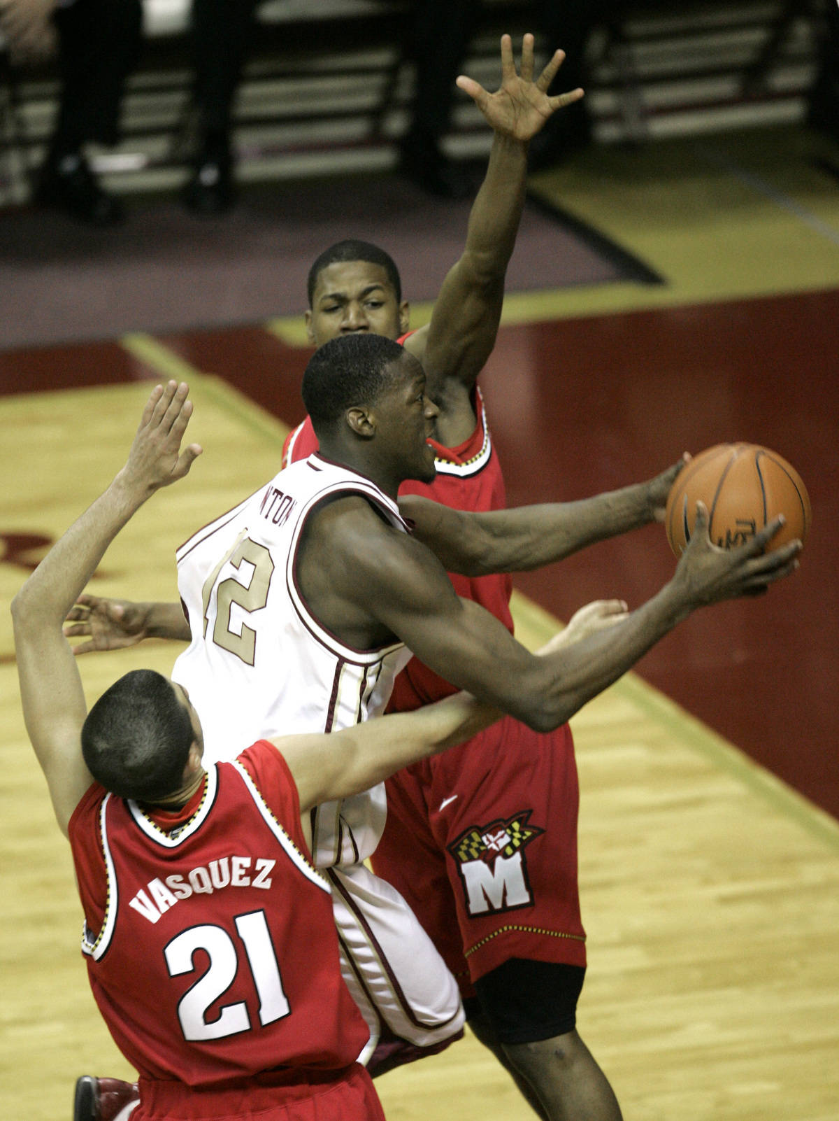 Florida State's Al Thonrton, center, drives for two points between Maryland's D.J. Strawberry, top, and Greivis Vasquez (21) during the second half of their college basketball game Tuesday, Jan. 30, 2007, in Tallahassee, Fla. Florida State won 96-79. (AP Photo/Phil Coale)