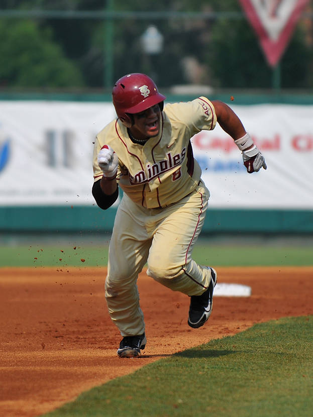 Devon Travis doubled in his first two at-bats, igniting FSU's 23-run outburst; its most prolific scoring game since routing Ohio State 37-6 for the 2009 Regional title.