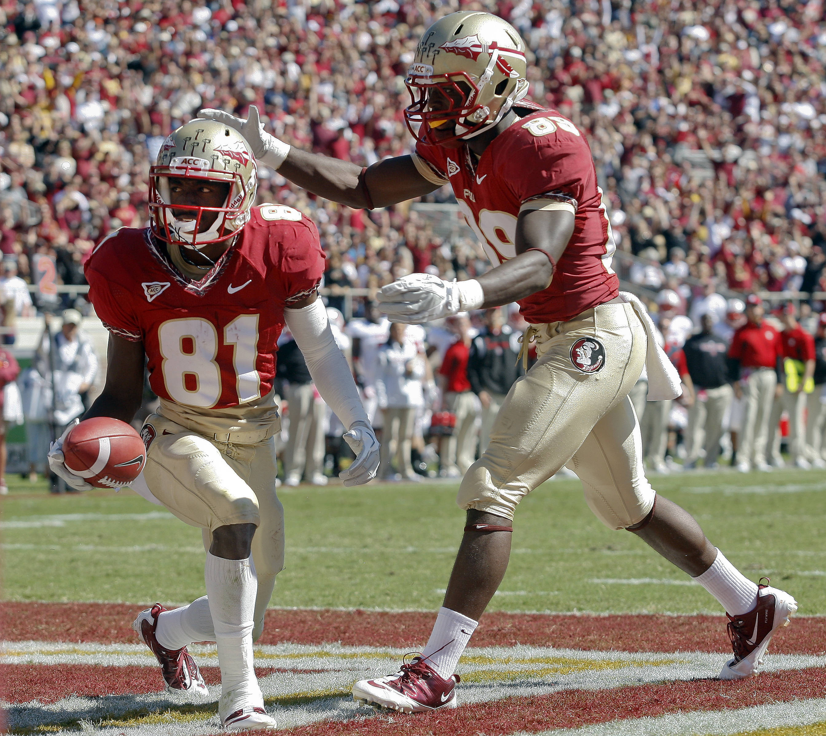 Florida State wide receiver Kenny Shaw (81) is congratulated by wide receiver Christian Green (89) after catching a 20-yard touchdown pass against North Carolina State in the second quarter of an NCAA college football game at Doak Campbell Stadium in Tallahassee, Fla., Saturday, Oct. 29, 2011. (AP Photo/Phil Sears)