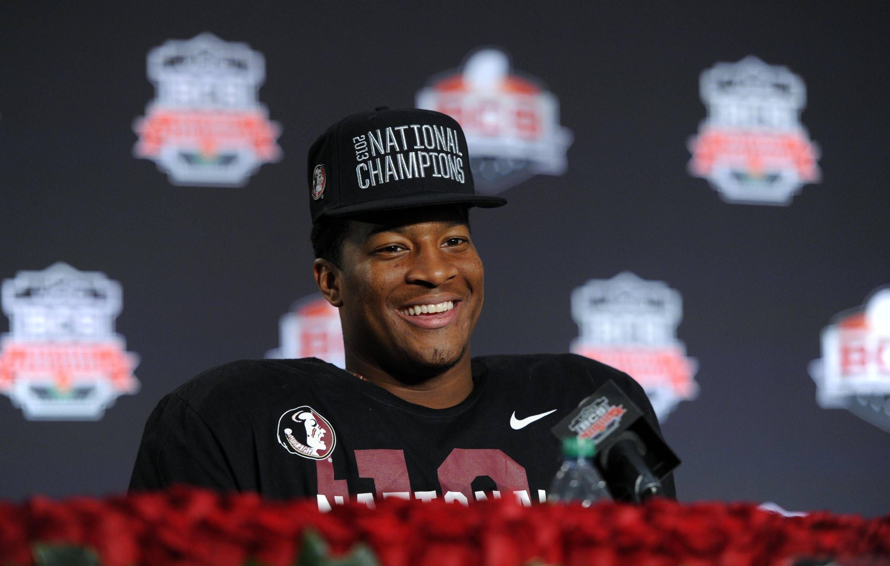 Jan 6, 2014; Pasadena, CA, USA; Florida State Seminoles quarterback Jameis Winston (5) at a press conference after the 2014 BCS National Championship game against the Auburn Tigers at the Rose Bowl.  Mandatory Credit: Kirby Lee-USA TODAY Sports