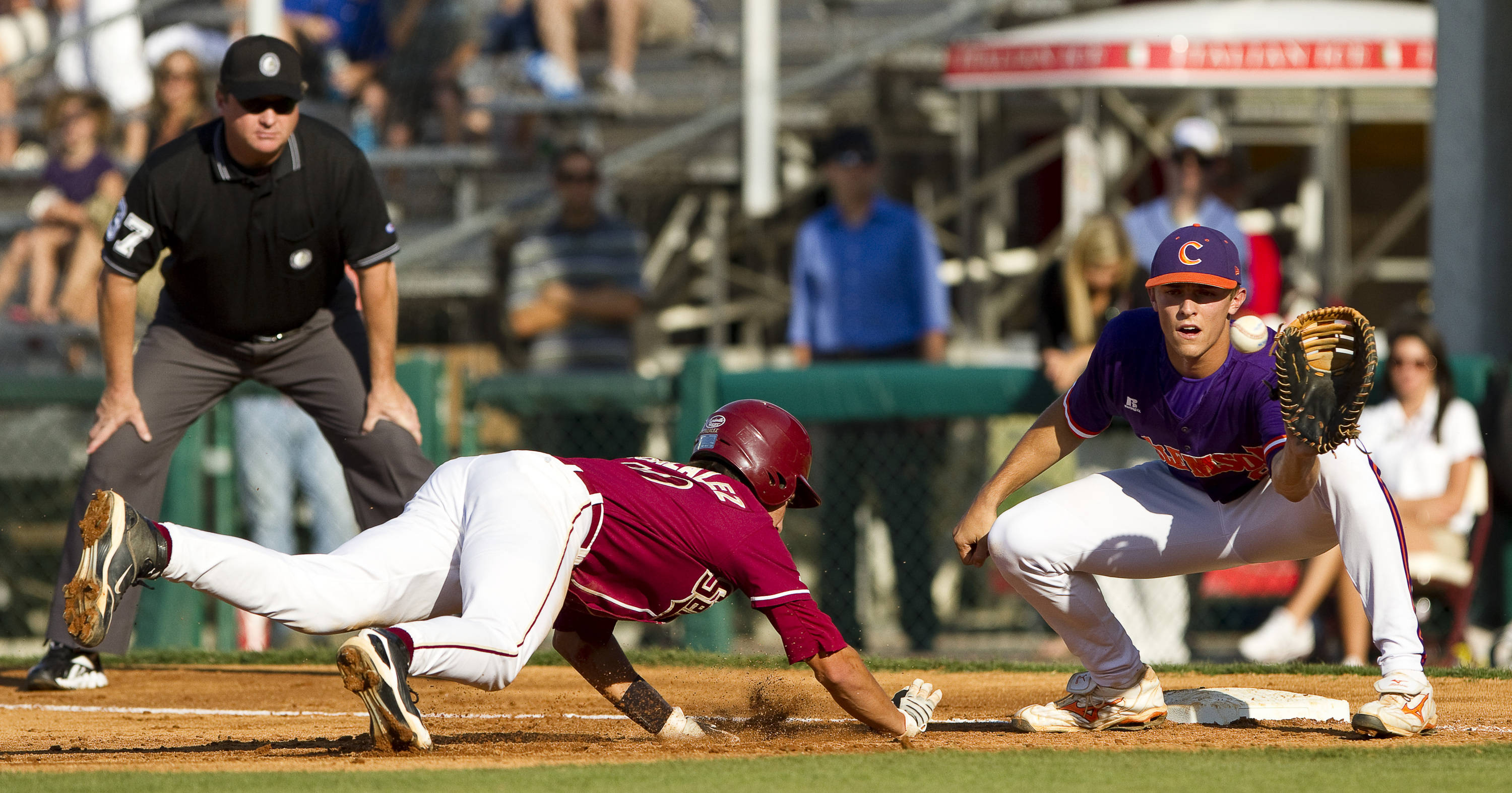 Justin Gonzalez (10) dives safely to first base.