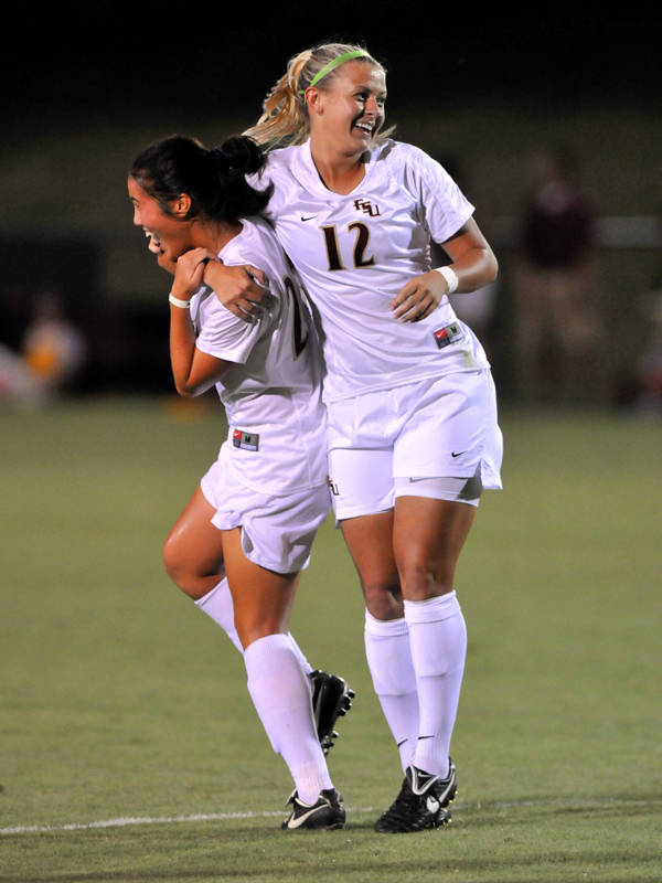 Rachel Lim and Breezy Hupp celebrate after a goal against the Jaguars.