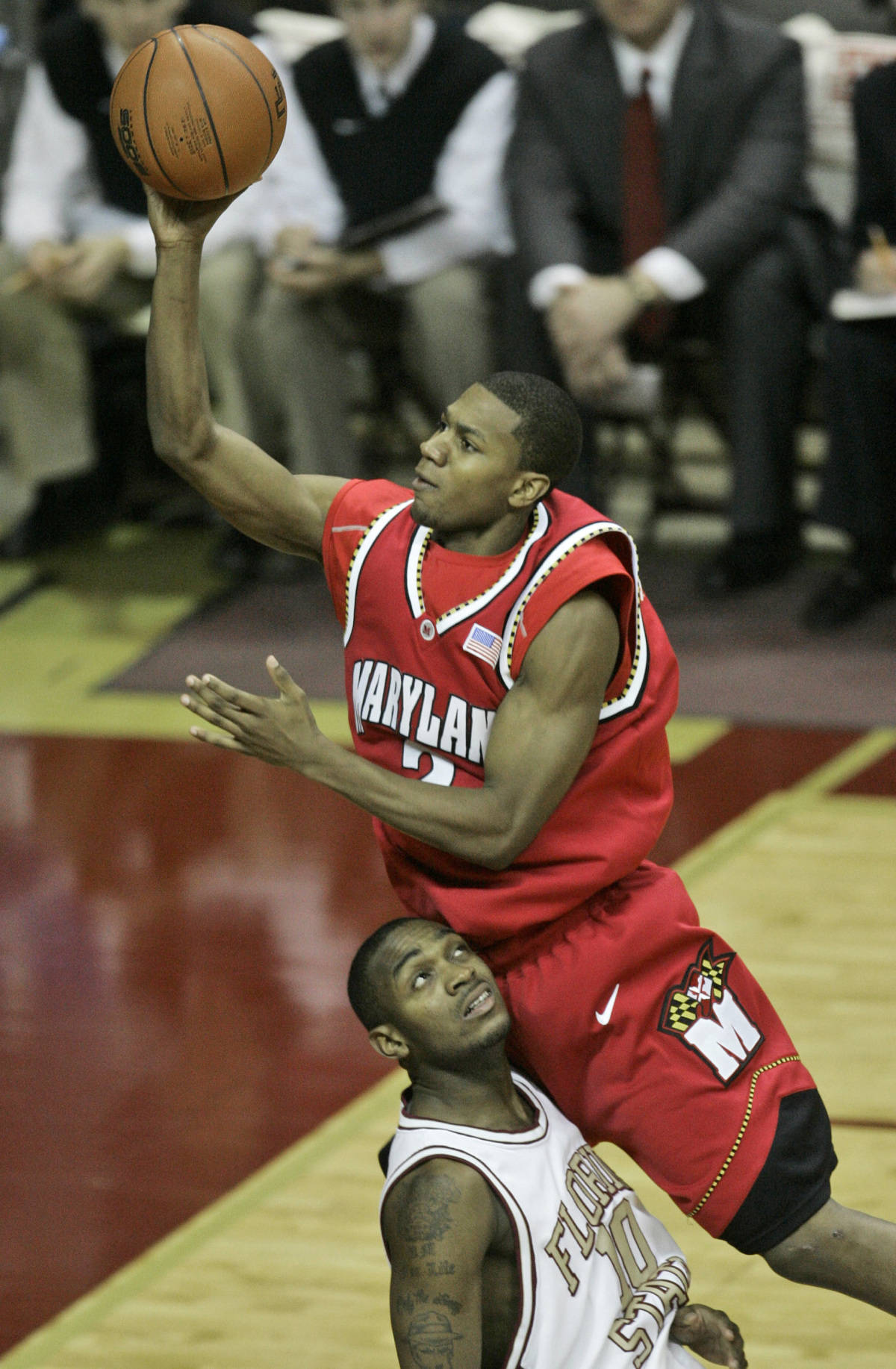 Maryland's D. J. Strawberry, top, goes over Florida State's Ralph Mims during the second half of a basketball game Tuesday, Jan. 30, 2007, in Tallahassee, Fla.(AP Photo/Phil Coale)