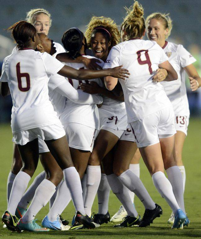 The Seminoles celebrate after Tiffany McCarty scores to tie the game in the second half.