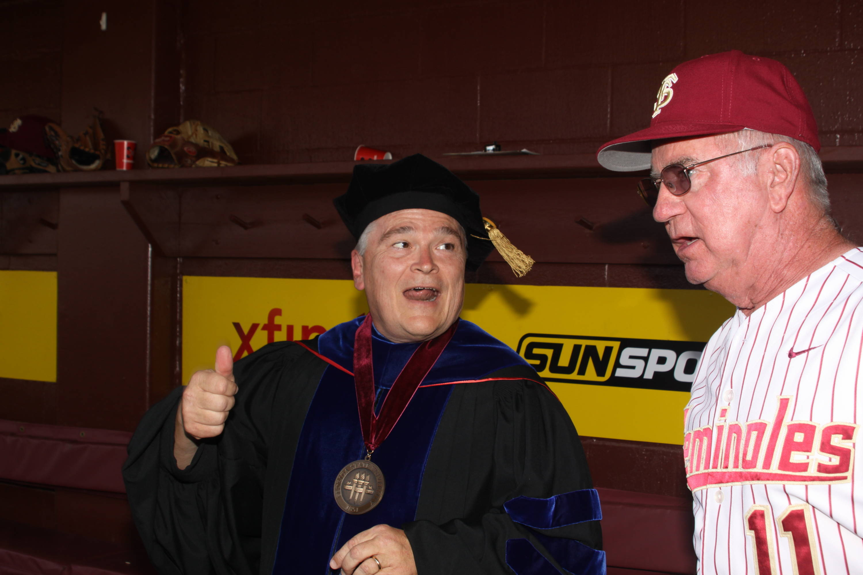 2011 Spring Graduation Ceremony held at Dick Howser Stadium to honor the graduating baseball seniors. President Barron with Mike Martin (11)