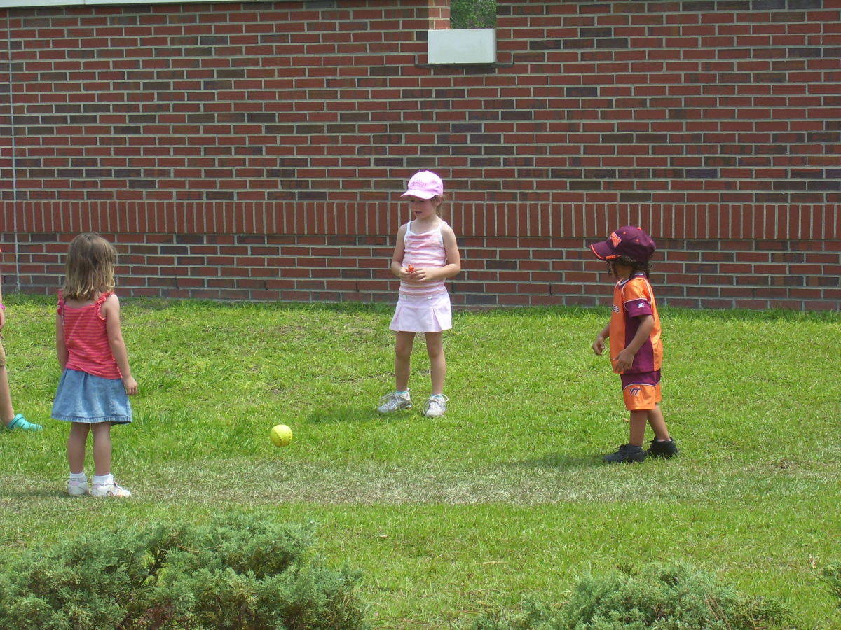 The kids playing their own softball.