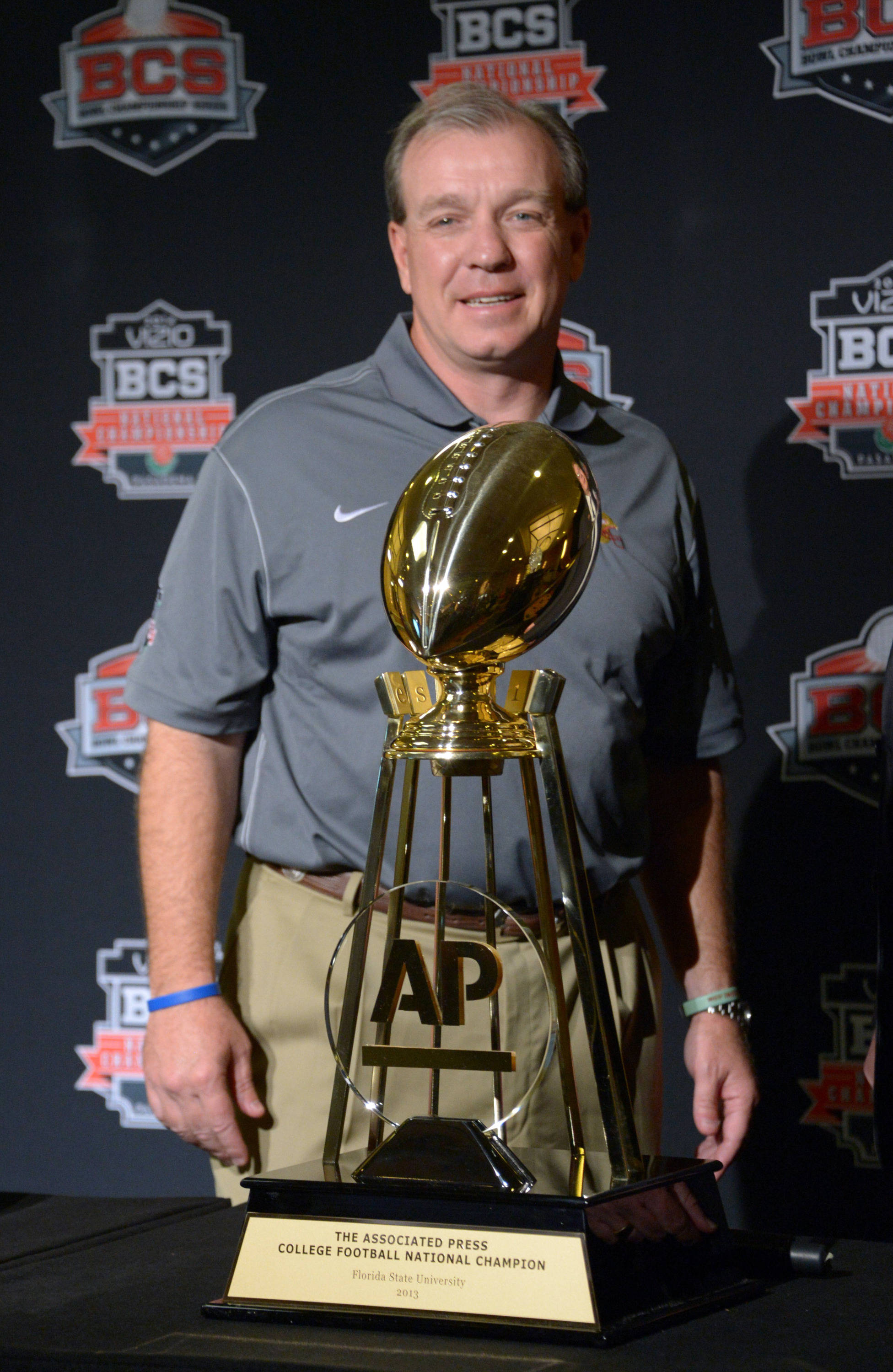 Florida State Seminoles coach Jimbo Fisher poses with the Associated Press college football national champion trophy at 2014 BCS National Championship press conference at Newport Beach Marriott. Mandatory Credit: Kirby Lee-USA TODAY Sports