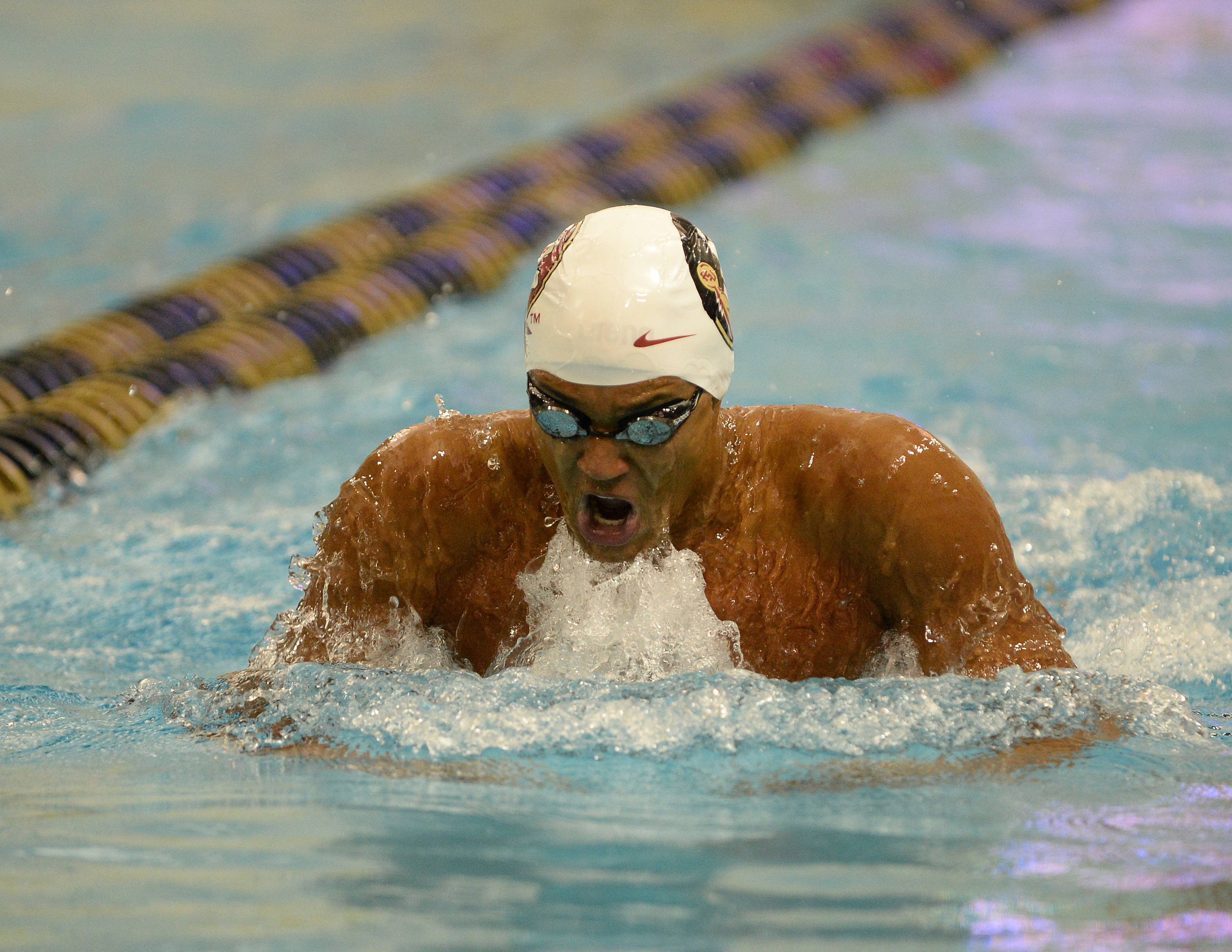 Jason Coombs swims the 100 breast - Mitch White