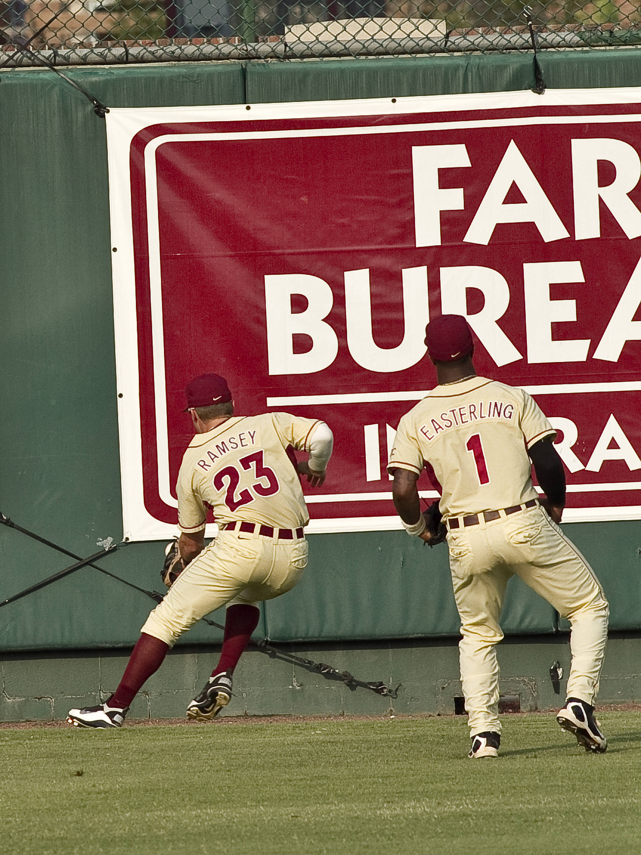James Ramsey (23) and Taiwan Easterling (1) chase down a ball in the gap in right-center field.