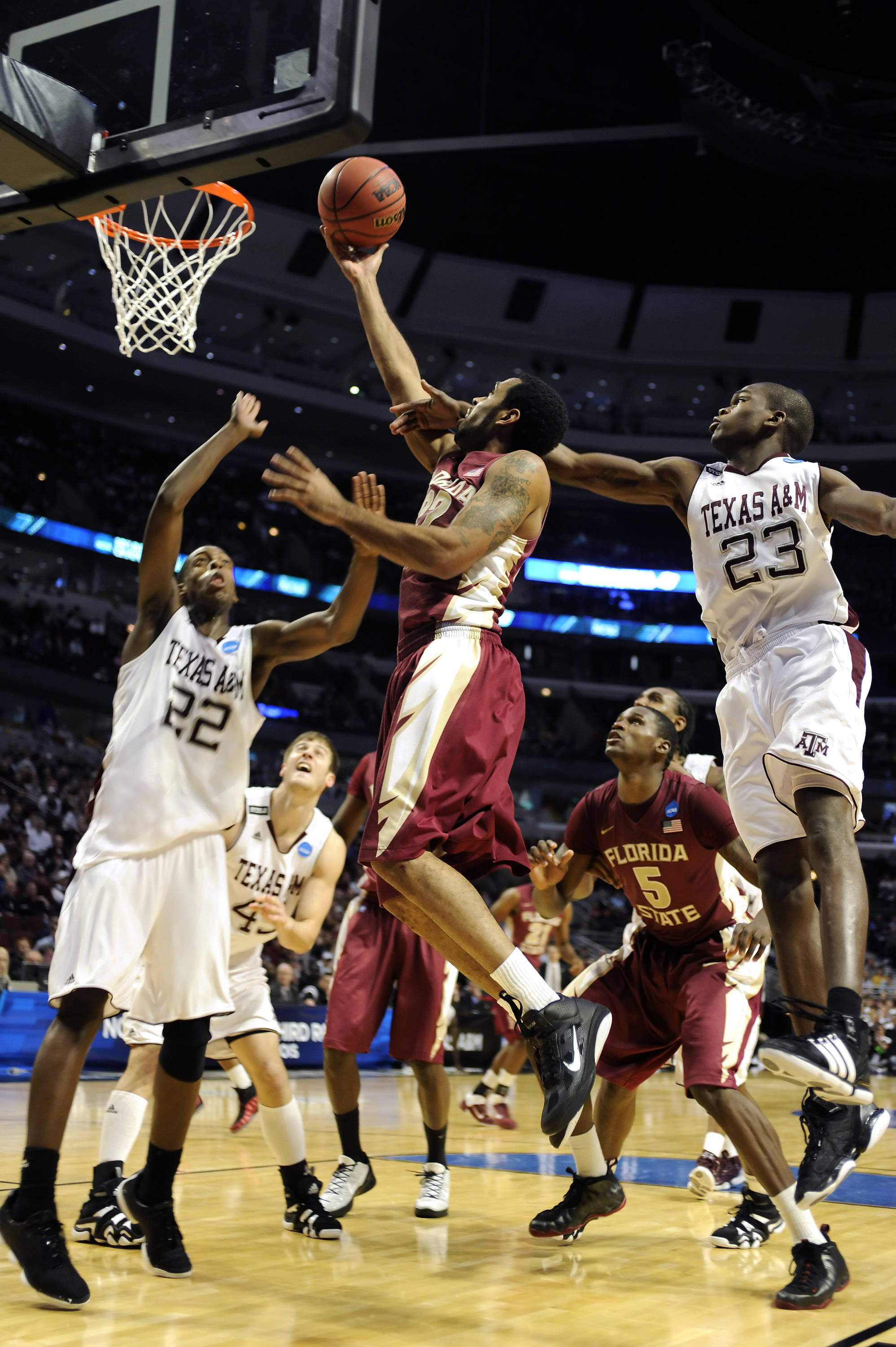 Derwin Kitchen goes up for a layup against Texas A&M
