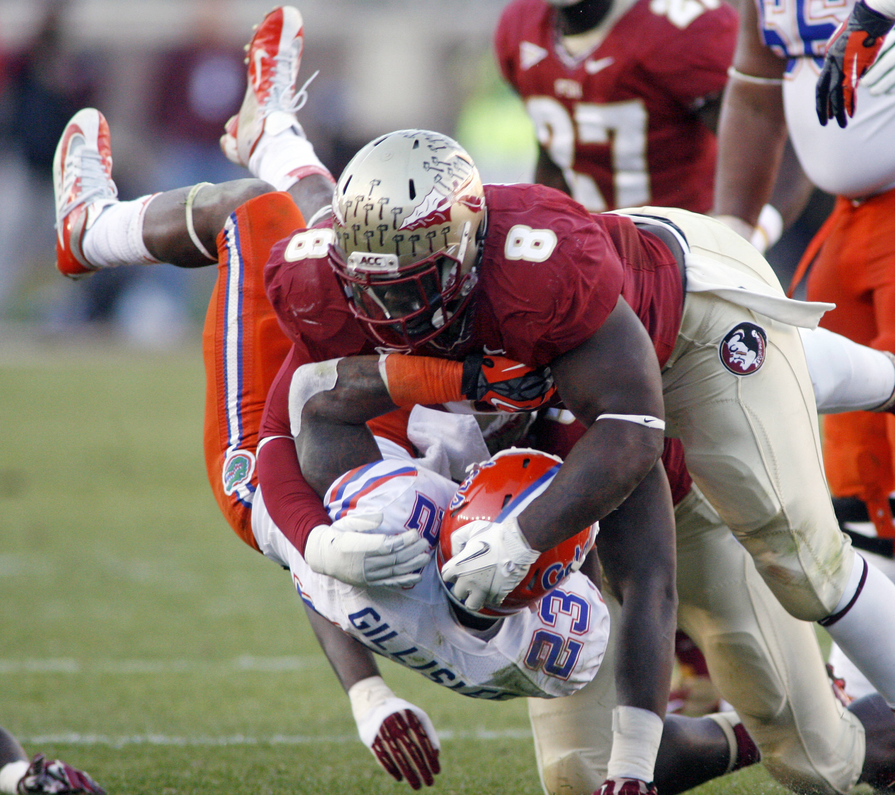 Florida State defensive tackle Timmy Jernigan (8) upends Florida running back Mike Gillislee (23). (AP Photo/Phil Sears)