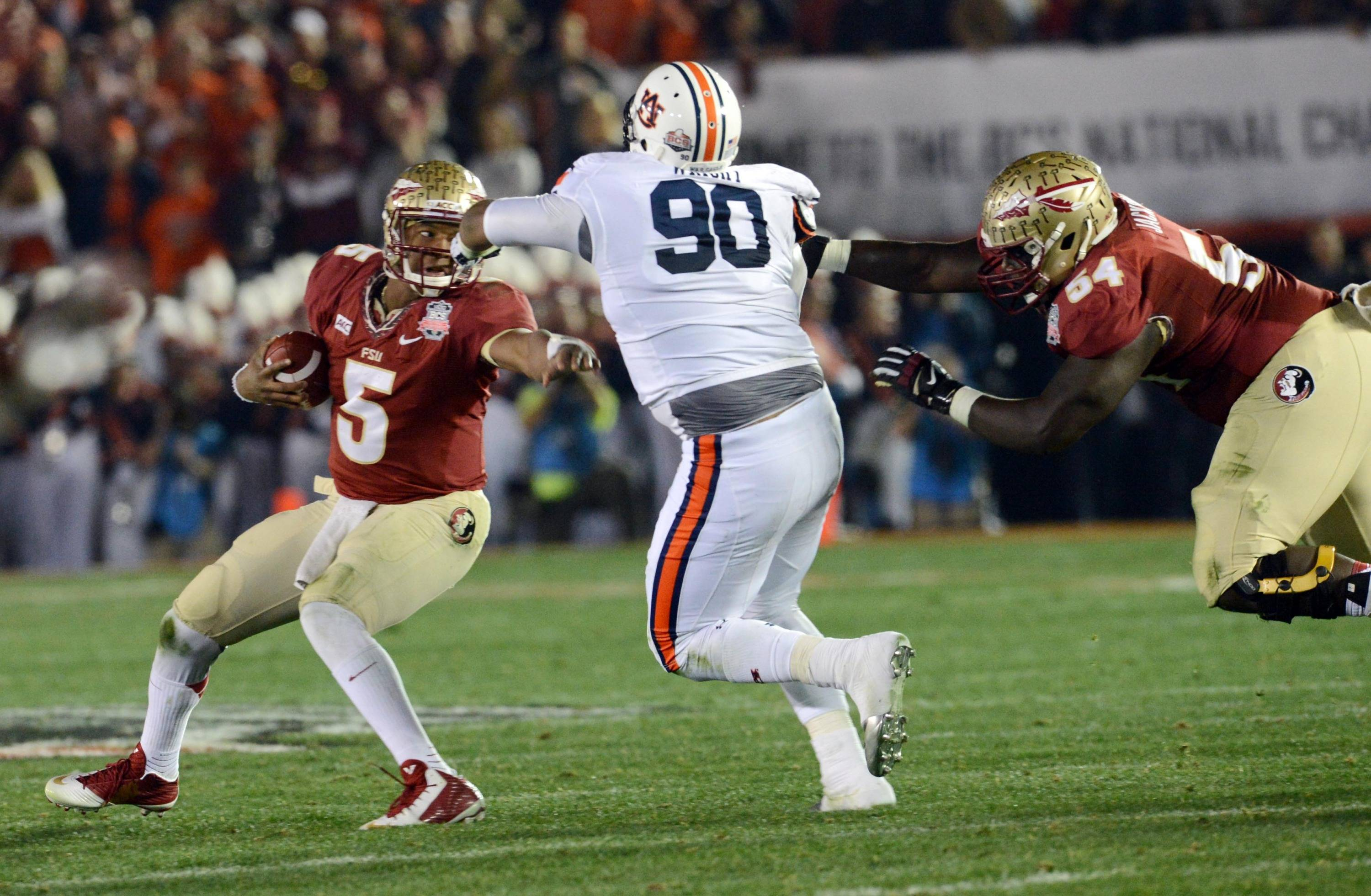 Jan 6, 2014; Pasadena, CA, USA; Florida State Seminoles quarterback Jameis Winston (5) runs against the Auburn Tigers during the first half of the 2014 BCS National Championship game at the Rose Bowl.  Mandatory Credit: Jayne Kamin-Oncea-USA TODAY Sports