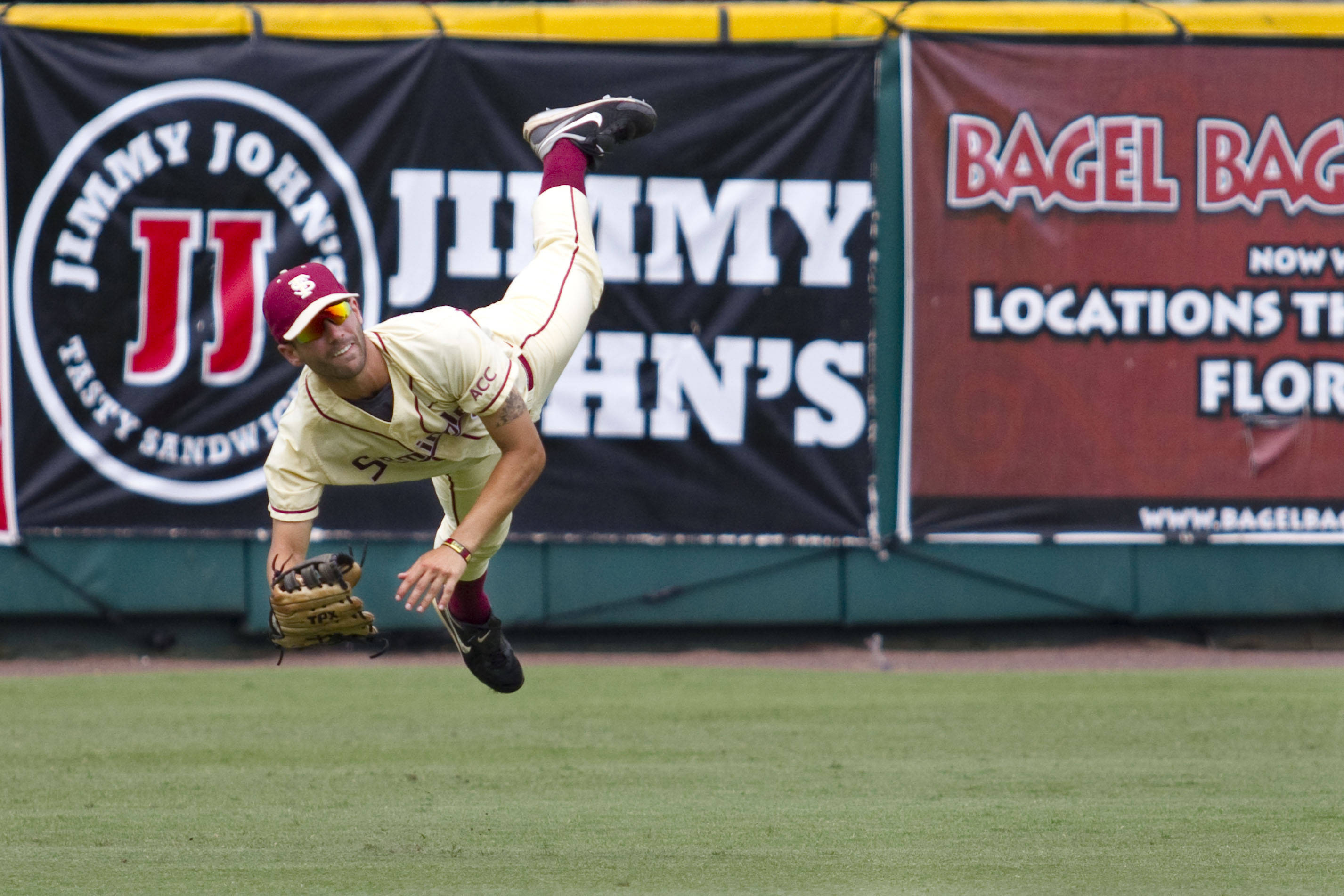 Ohmed Danesh (2) falls after making a lunging throw to the infield in the 7th inning.