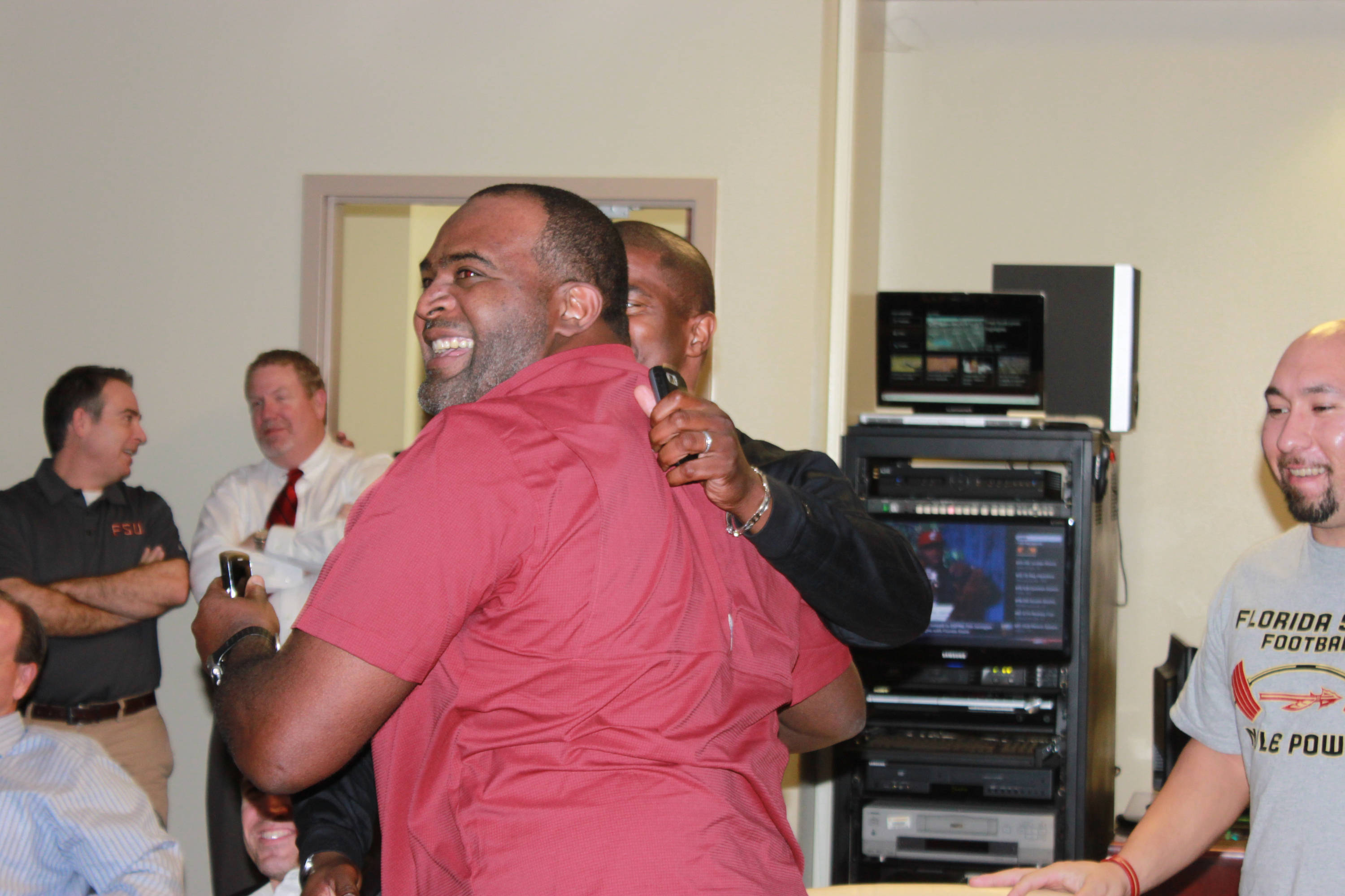 Odell Haggins cannot stop smiling after Tim Jernigan announced that we will enroll at Florida State