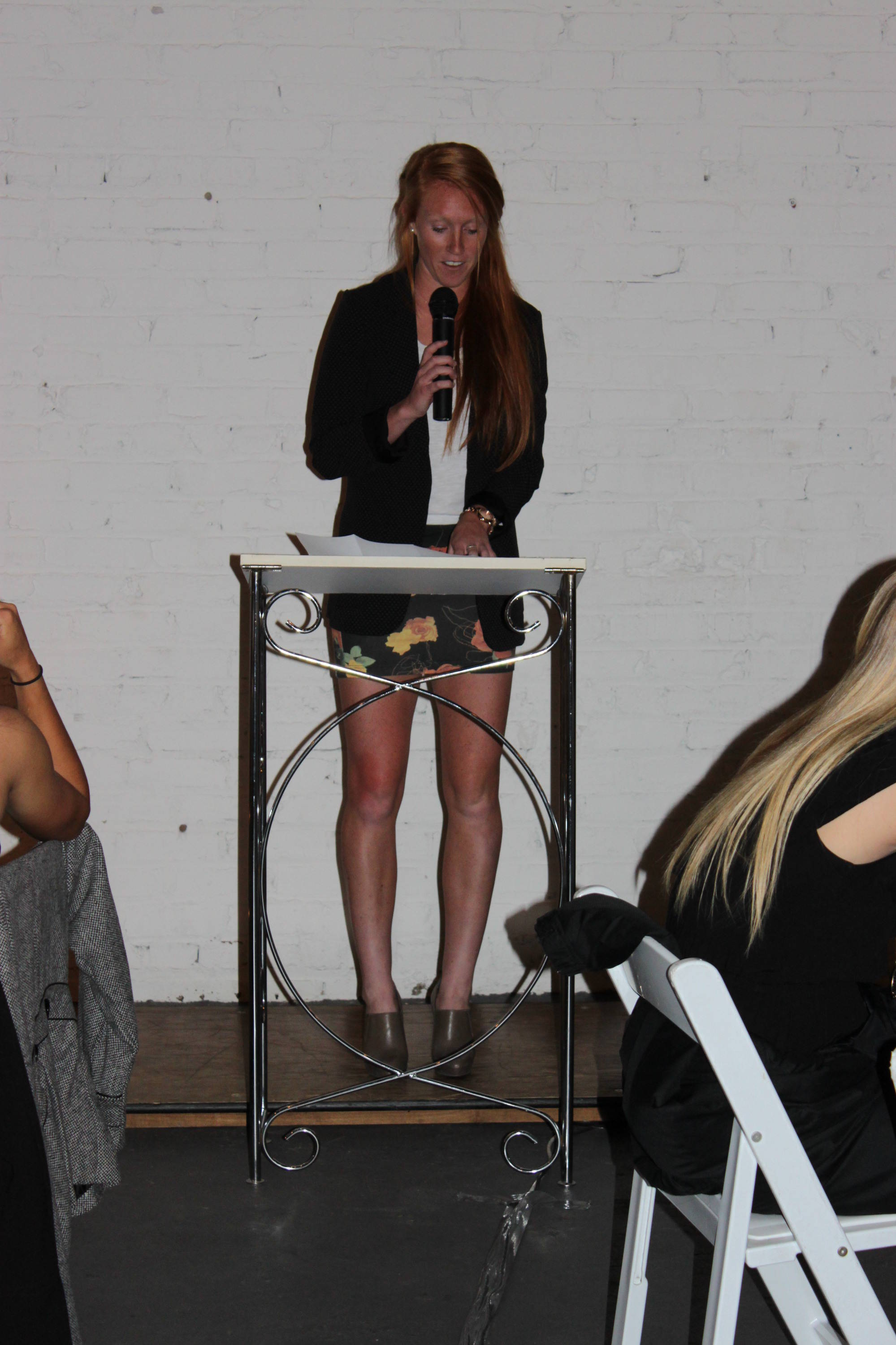 Senior Tori Huster speaks at the 2011 College Cup Banquet.