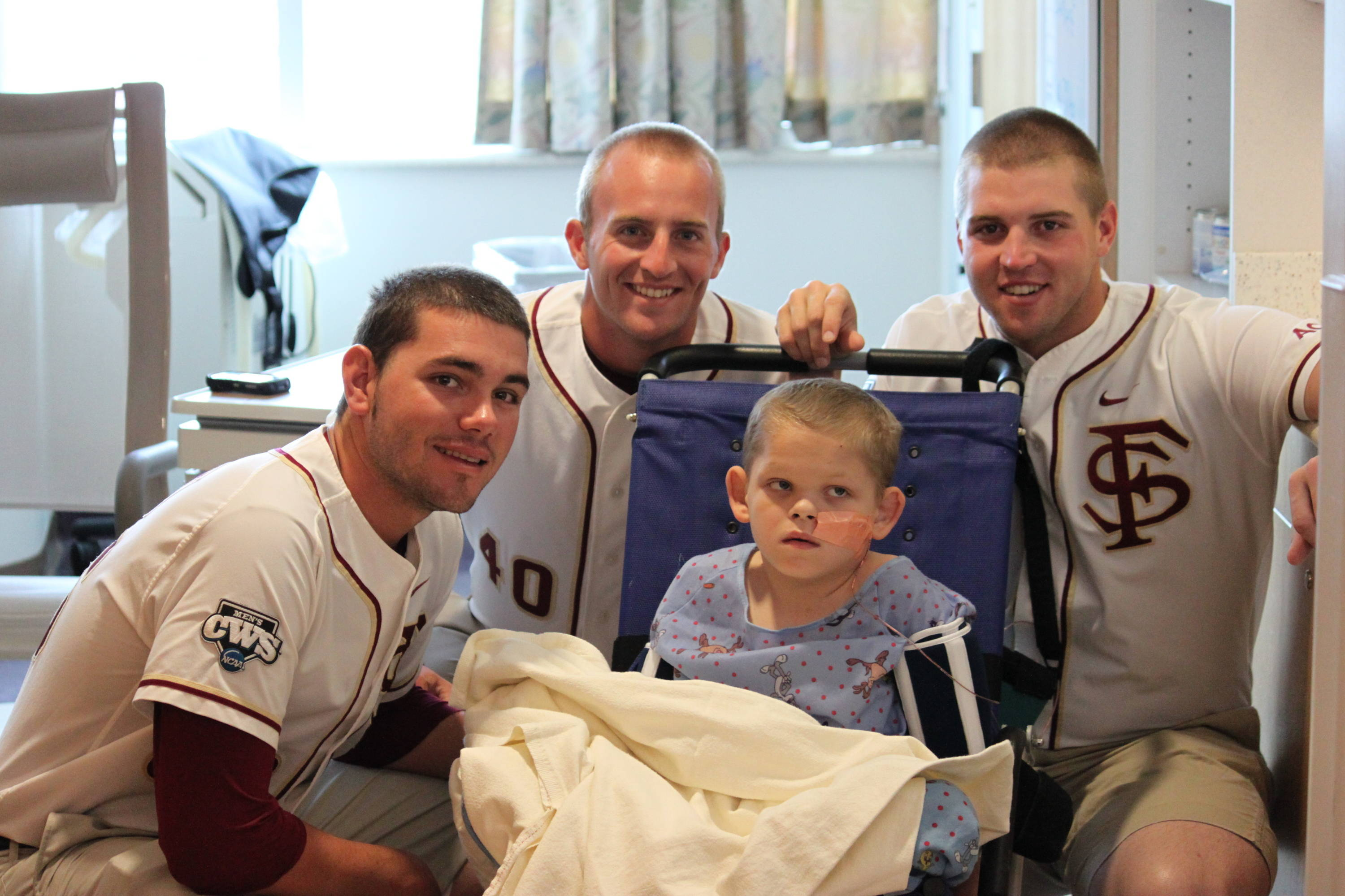 Robby Scott, Brandon Roth and Geoff Parker on a visit to the Children's Hospital in Omaha