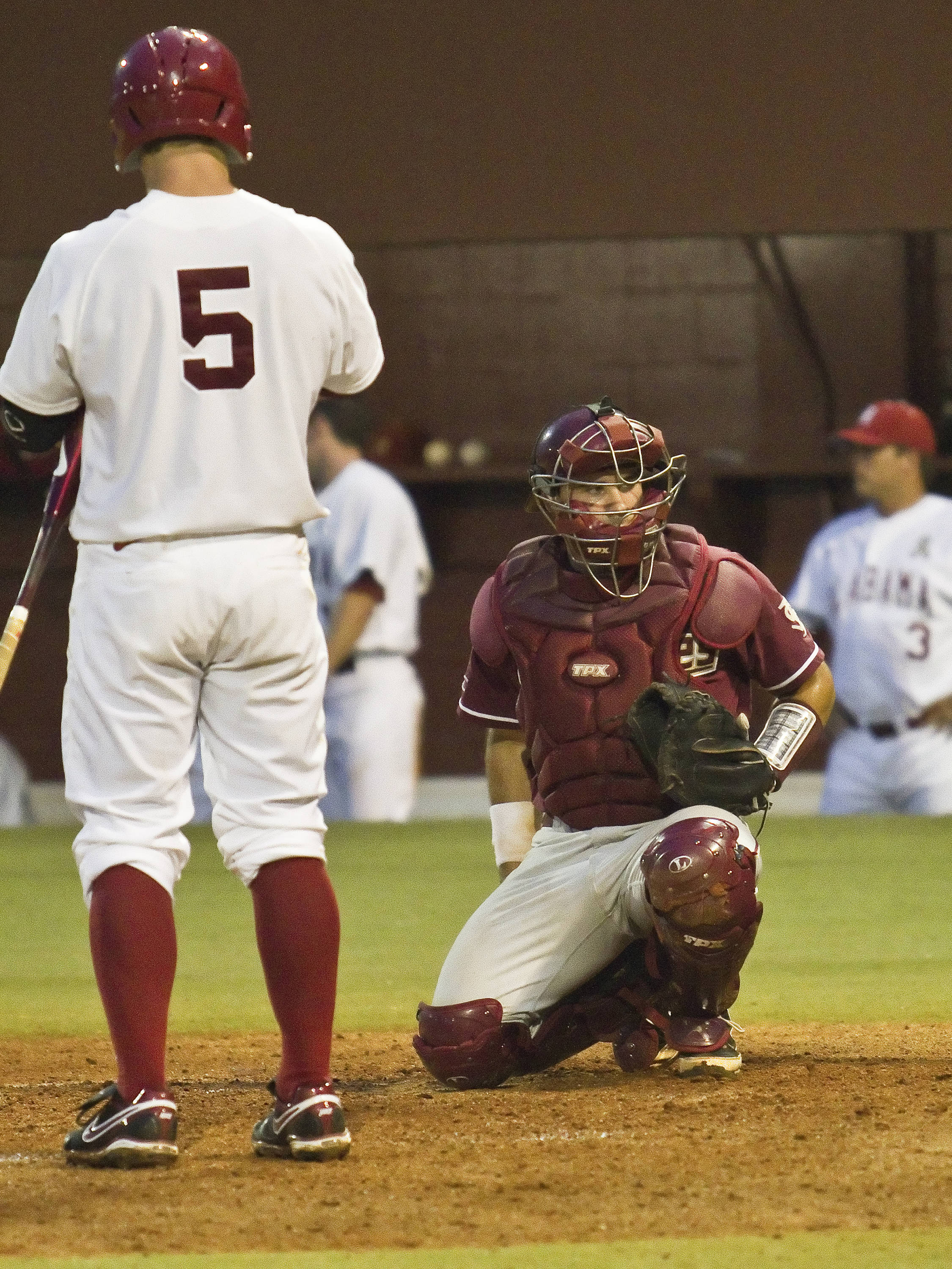 Catcher Rafael Lopez (29) getting signals from the bench
