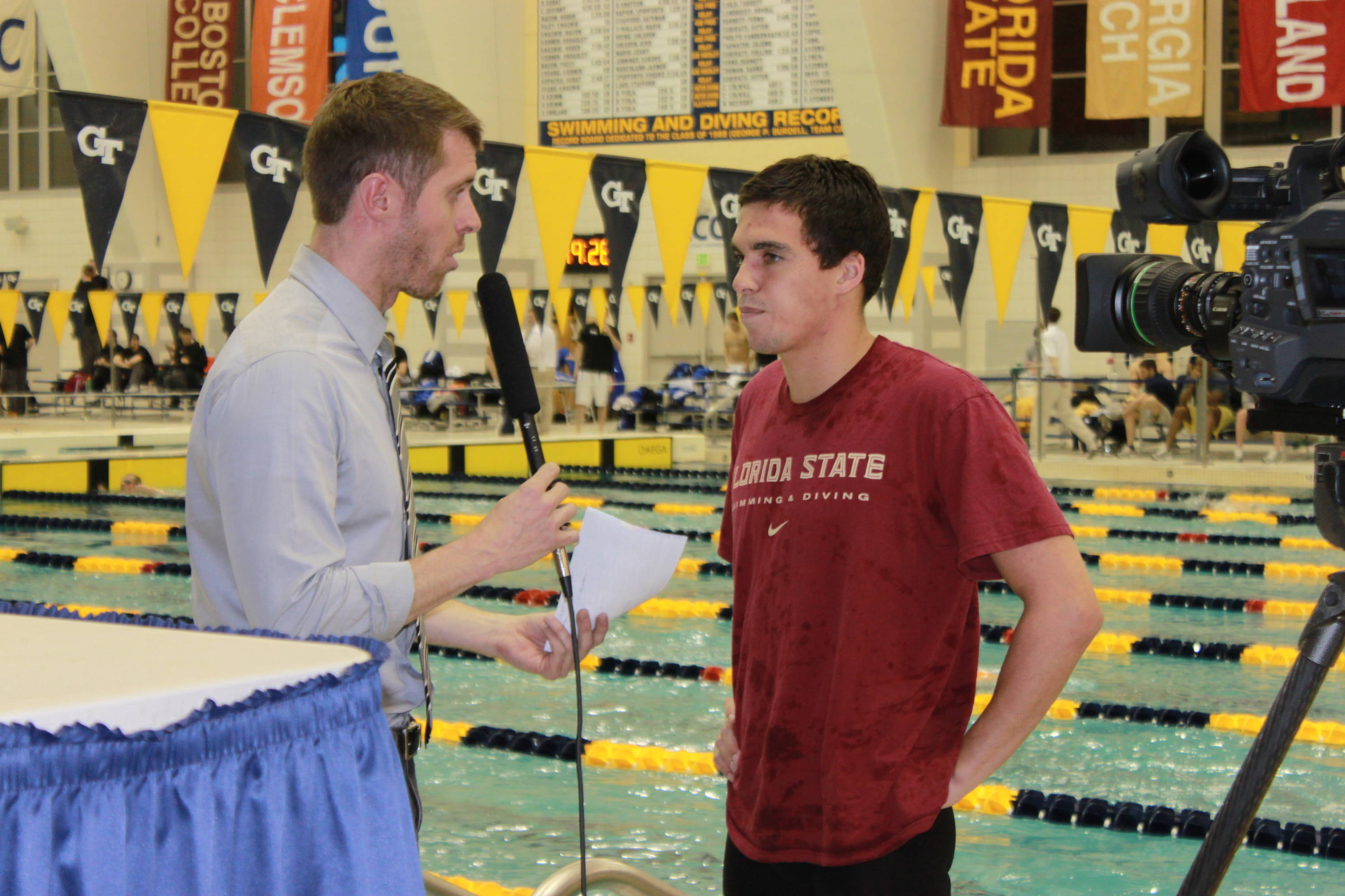 Rob Holderness does an interview with the ACC after winning te 100 breast