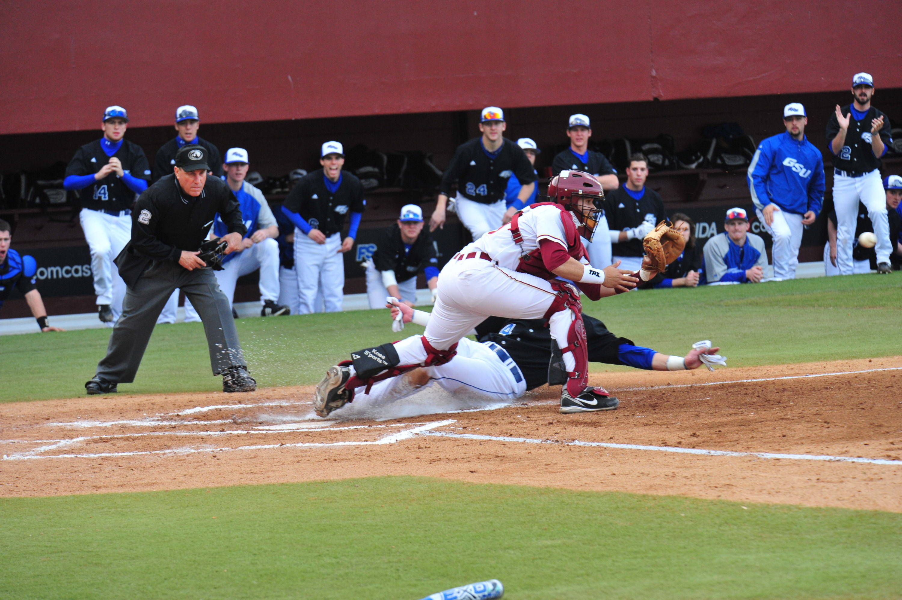 Rafael Lopez attempts a tag at the plate