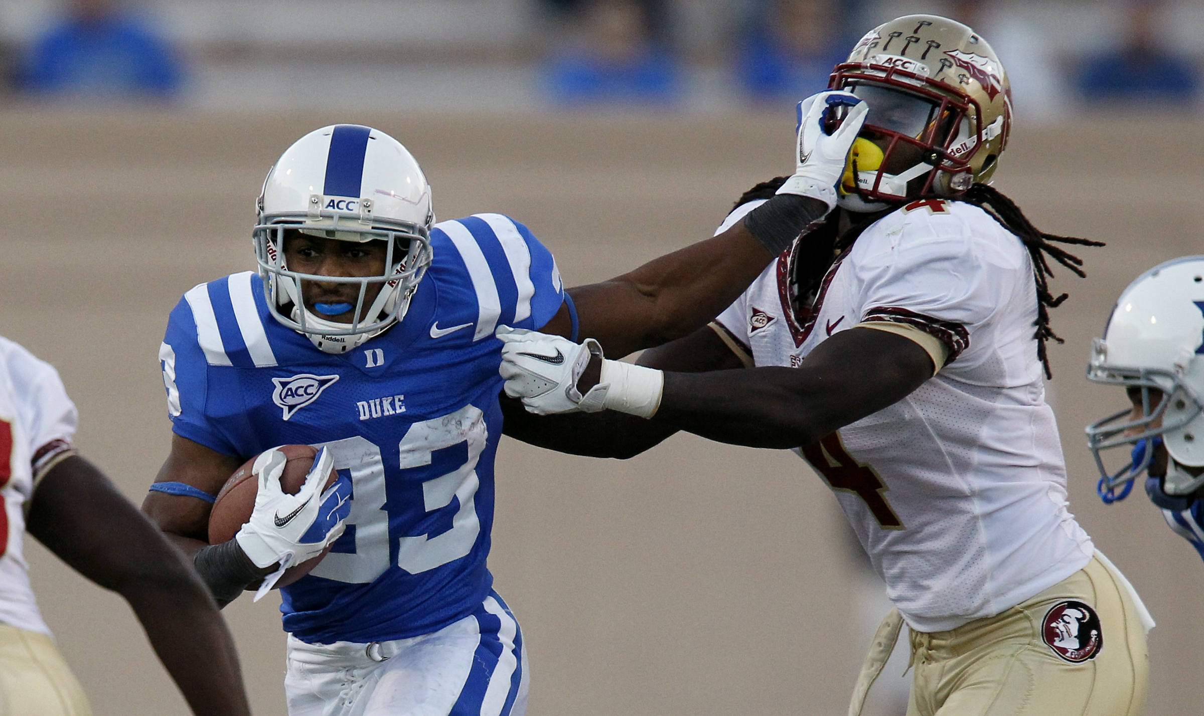 Florida State safety Terrance Parks (4) withstands a stiff-arm and tries to bring down Duke running back Desmond Scott. (AP Photo/The News & Observer, Chuck Liddy)