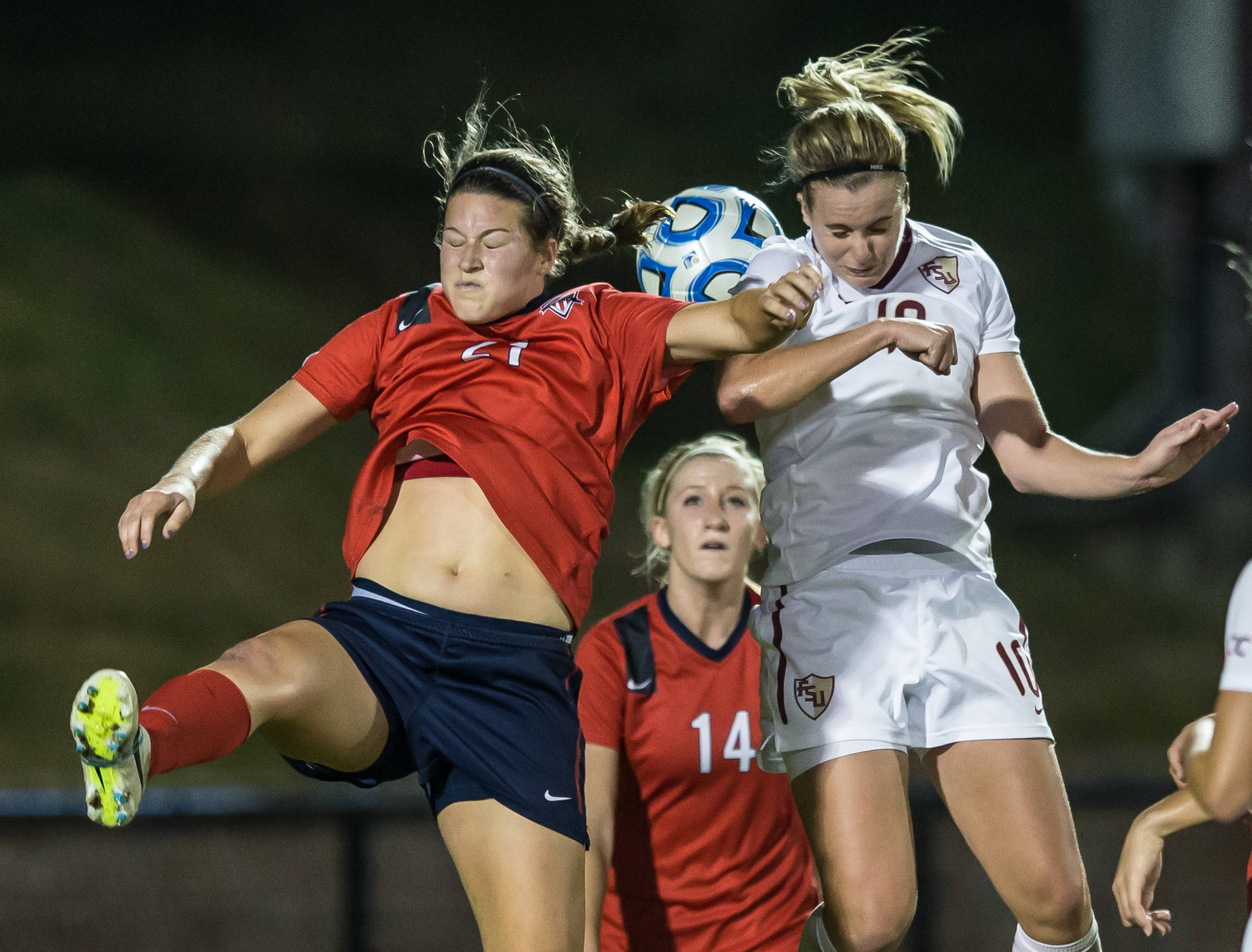 Berglind Thorvaldsdottir (10) and Ole Miss's Mandy McCalla fight for possession.