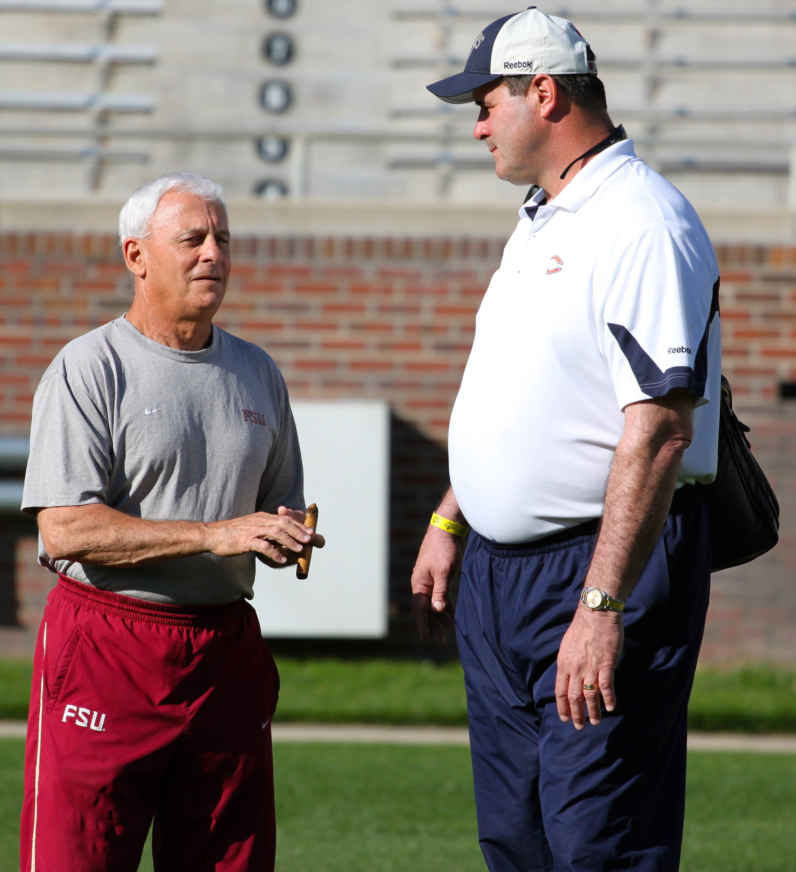 Florida State offensive line coach Rick Trickett talking with Chicago Bears offensive line coach Mike Tice.
