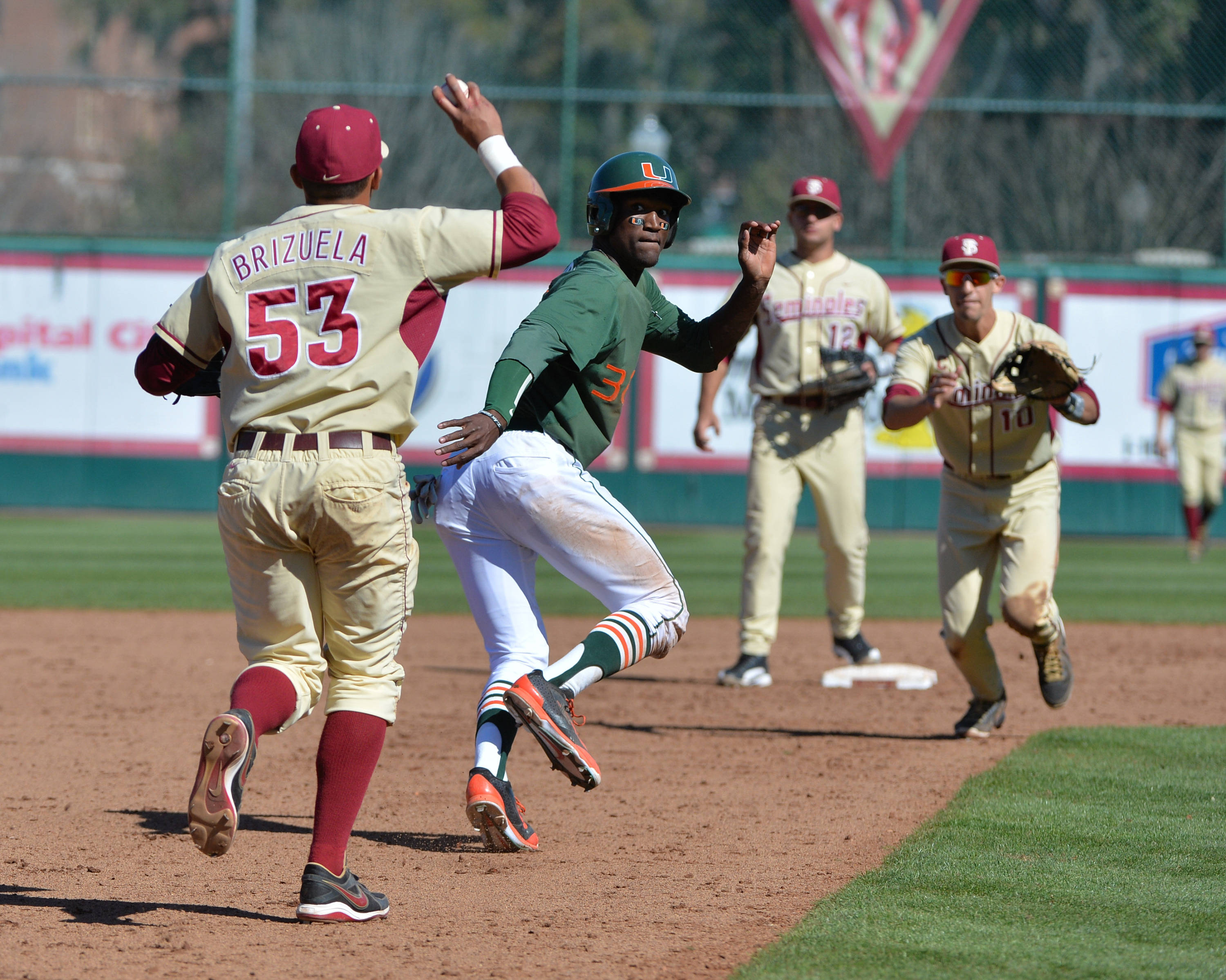 Jose Brizuela and Justin Gonzalez get Miami's Dale Carey in a run down.
