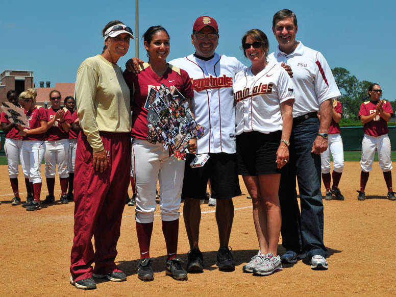 Monica Montez with her parents, head coach Lonni Alameda and athletics director Randy Spetman.
