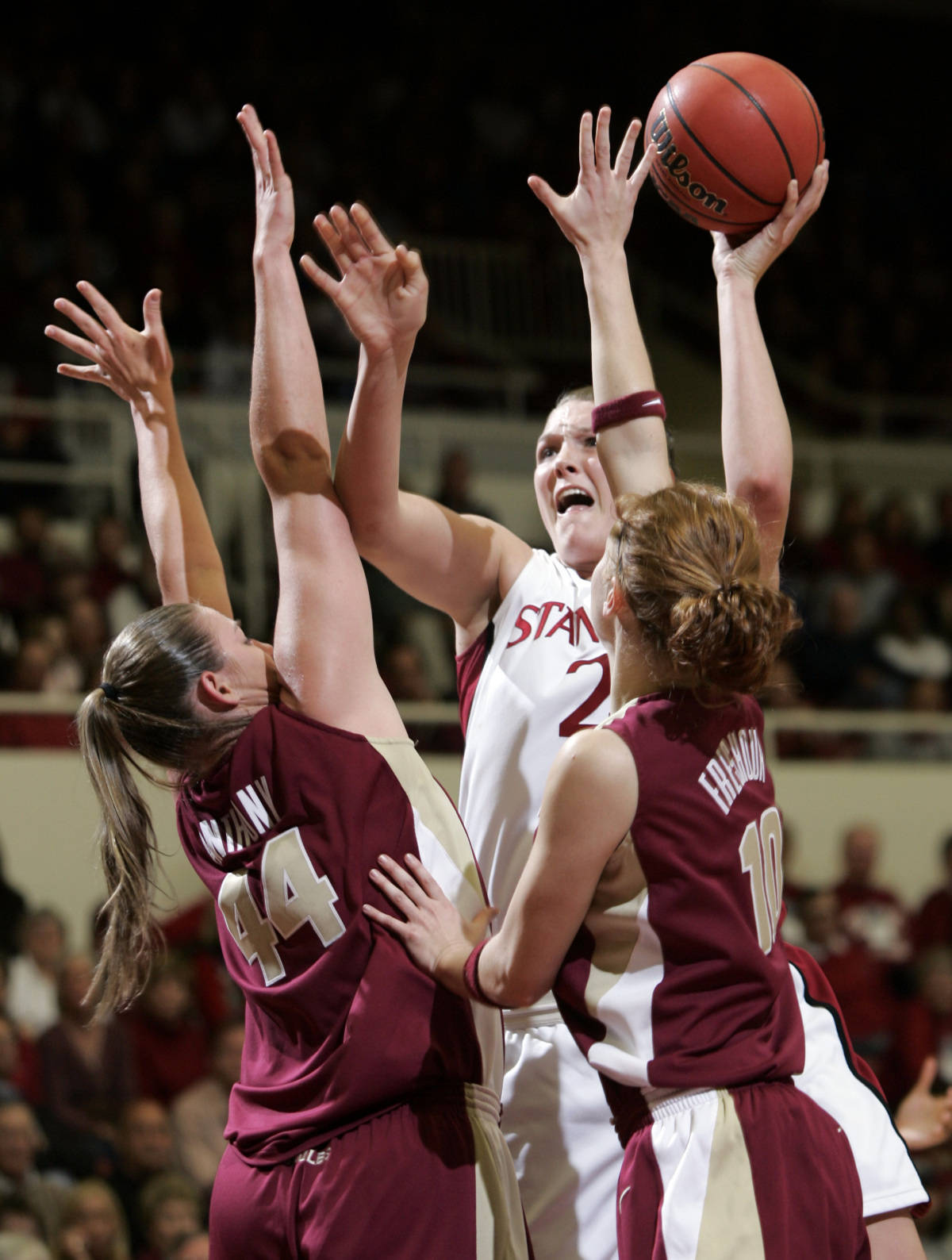 Stanford center Jayne Appel (2) is closely guarded by Florida State center Nikki Anthony (44) and guard Mara Freshour (10) in the first half of their second-round game in the NCAA women's basketball tournament in Stanford, Calif., Monday, March 19, 2007. (AP Photo/Paul Sakuma)