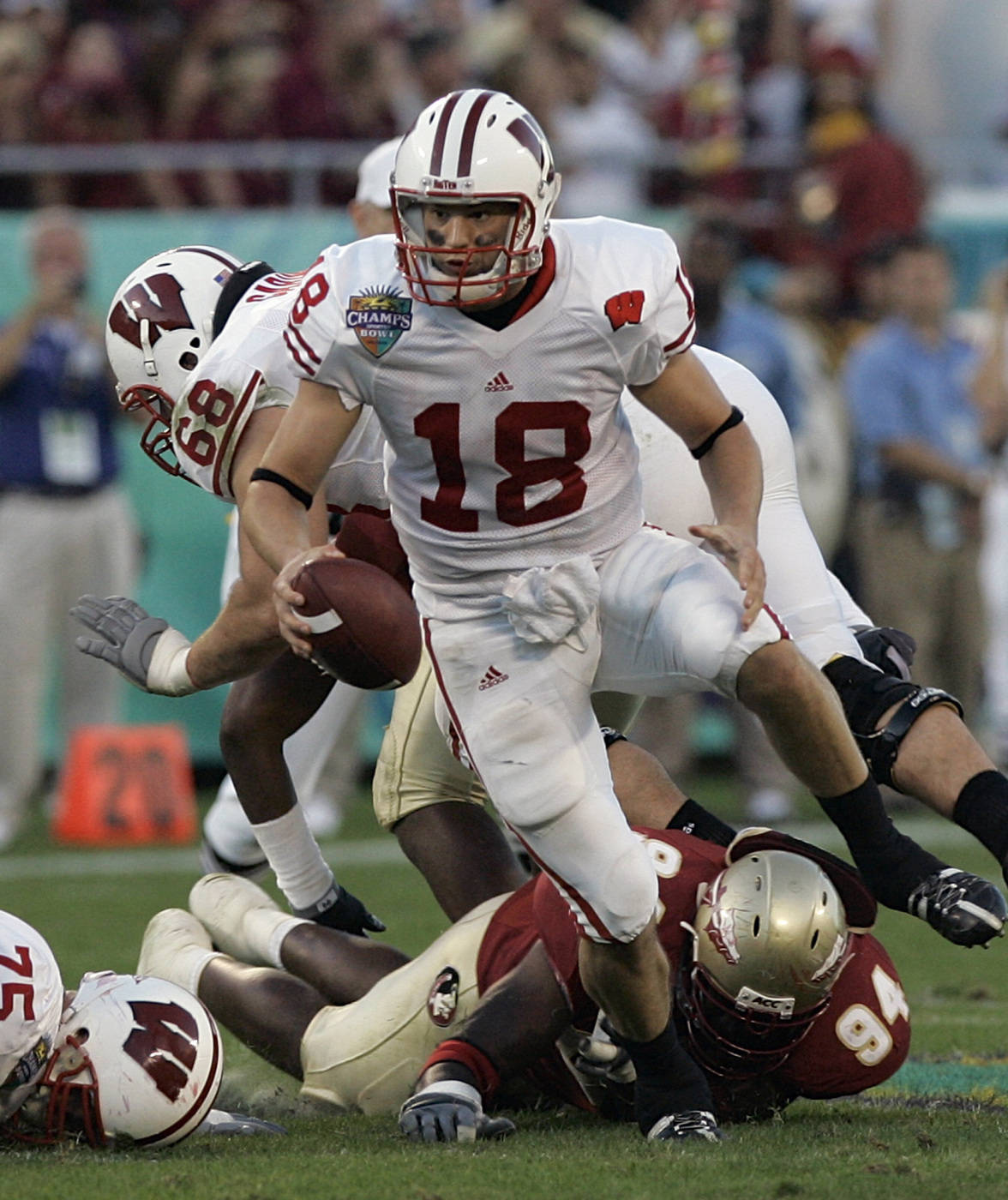 Wisconsin quarterback Dustin Sherer (18) scrambles away from Florida State defensive tackle Justin Mincey (94) during the first half.(AP Photo/John Raoux)