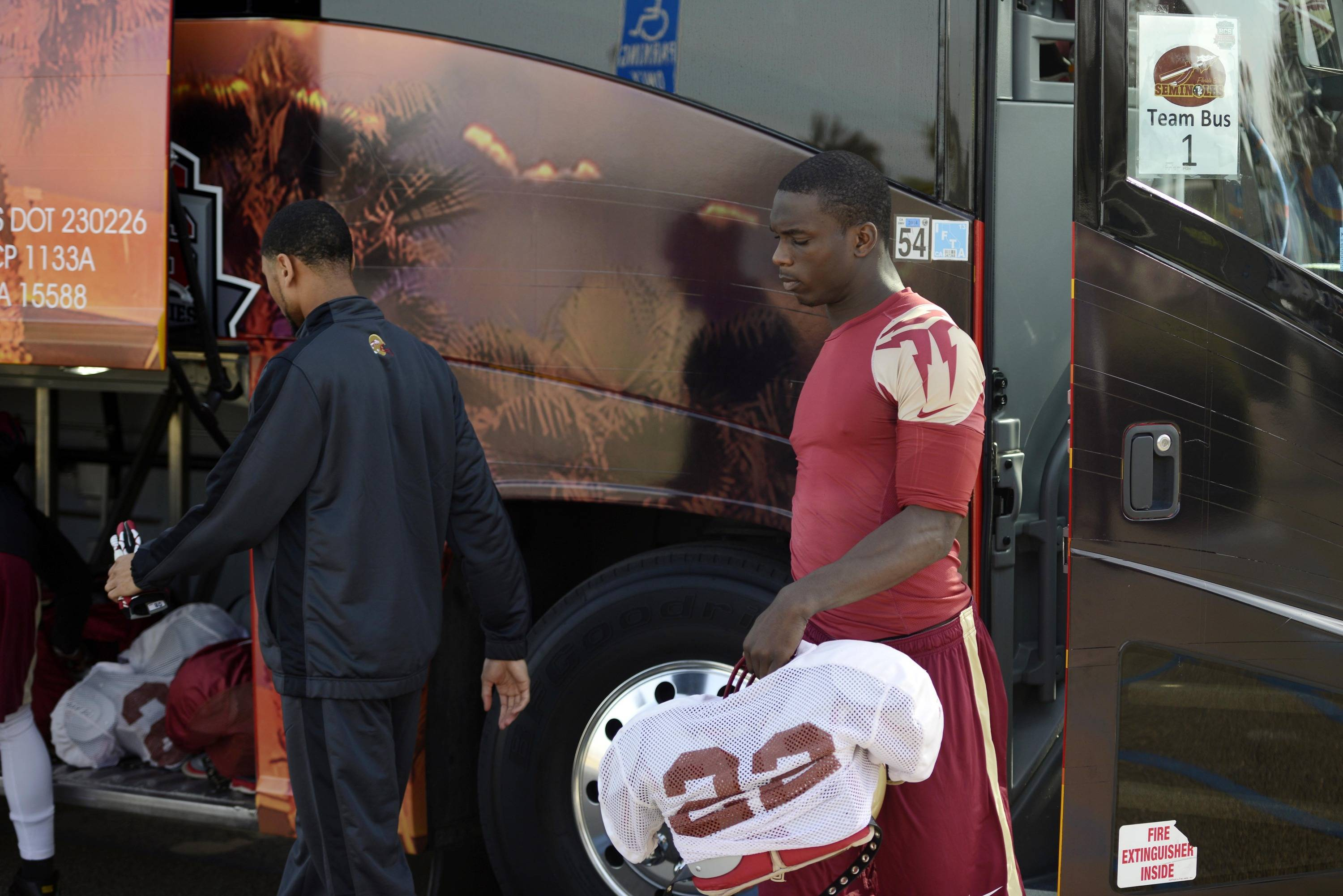 Jan 3, 2014; Orange, CA, USA; Florida State Seminoles linebacker Telvin Smith (22) exits the bus during practice for the BCS National Championship football game against the Auburn Tigers at Orange Coast College. Mandatory Credit: Kelvin Kuo-USA TODAY Sports