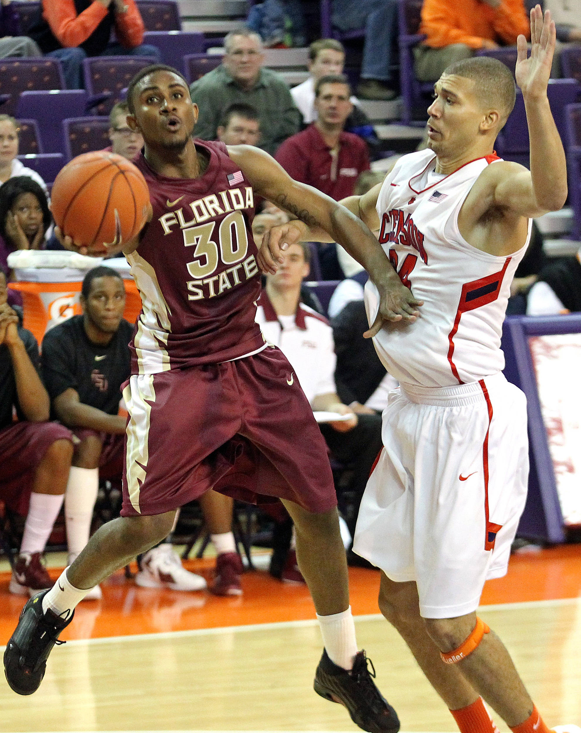 Florida State's Ian Miller, left, flips the ball to the basket in front of Clemson's Milton Jennings during the second half. (AP Photo/Anderson Independent-Mail, Mark Crammer)